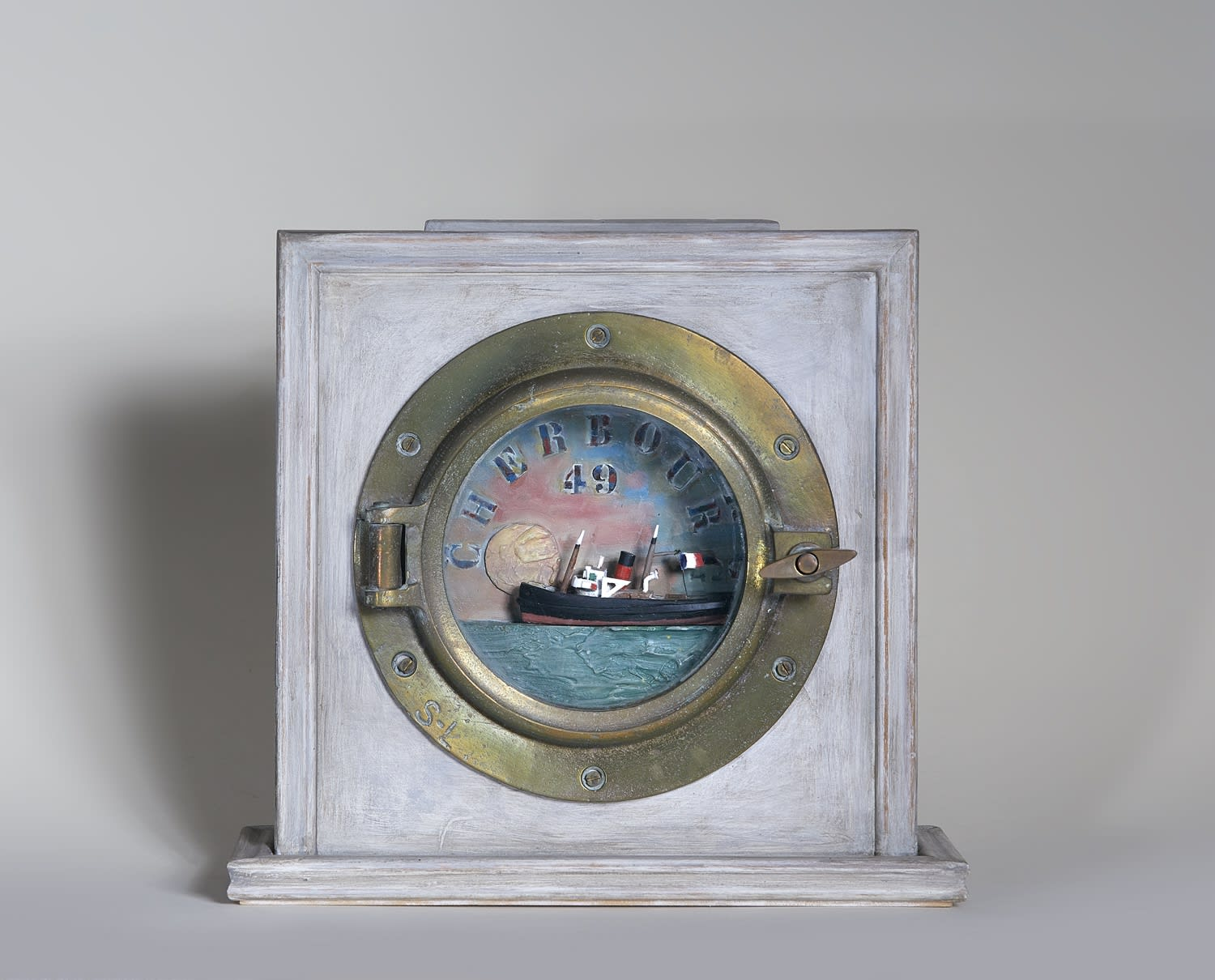 Alfred Cohen (1920-2001) Cherbourg 1949 c. 1999 Assemblage: wood, brass porthole, glass, and mixed media 33 x 31.8 cm © Estate of Alfred Cohen 2020