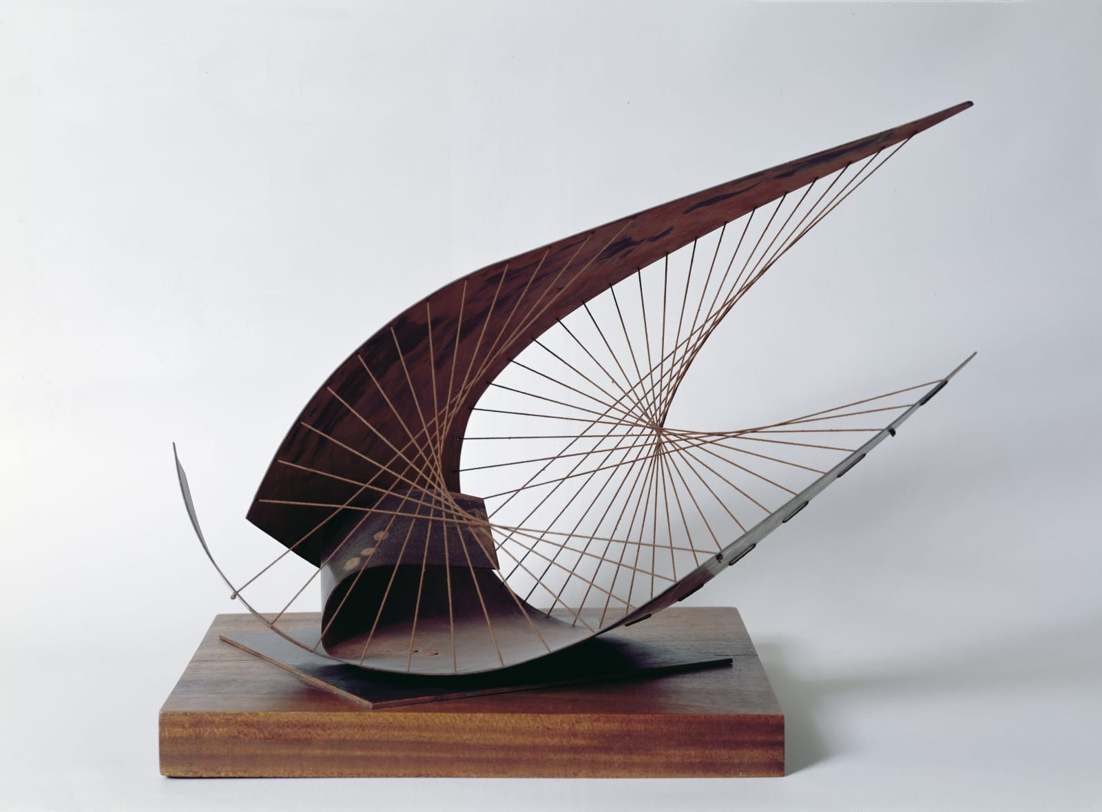 Dame Barbara HEPWORTH (1903 – 1975) Stringed Figure (Curlew) Version I, 1956 Brass and cotton string on a wooden base 16 ½ x 19 ¼ x 11 3/8 inches / 42 x 49 x 29 cm Cast in an edition of 1 of 9, BH 225A