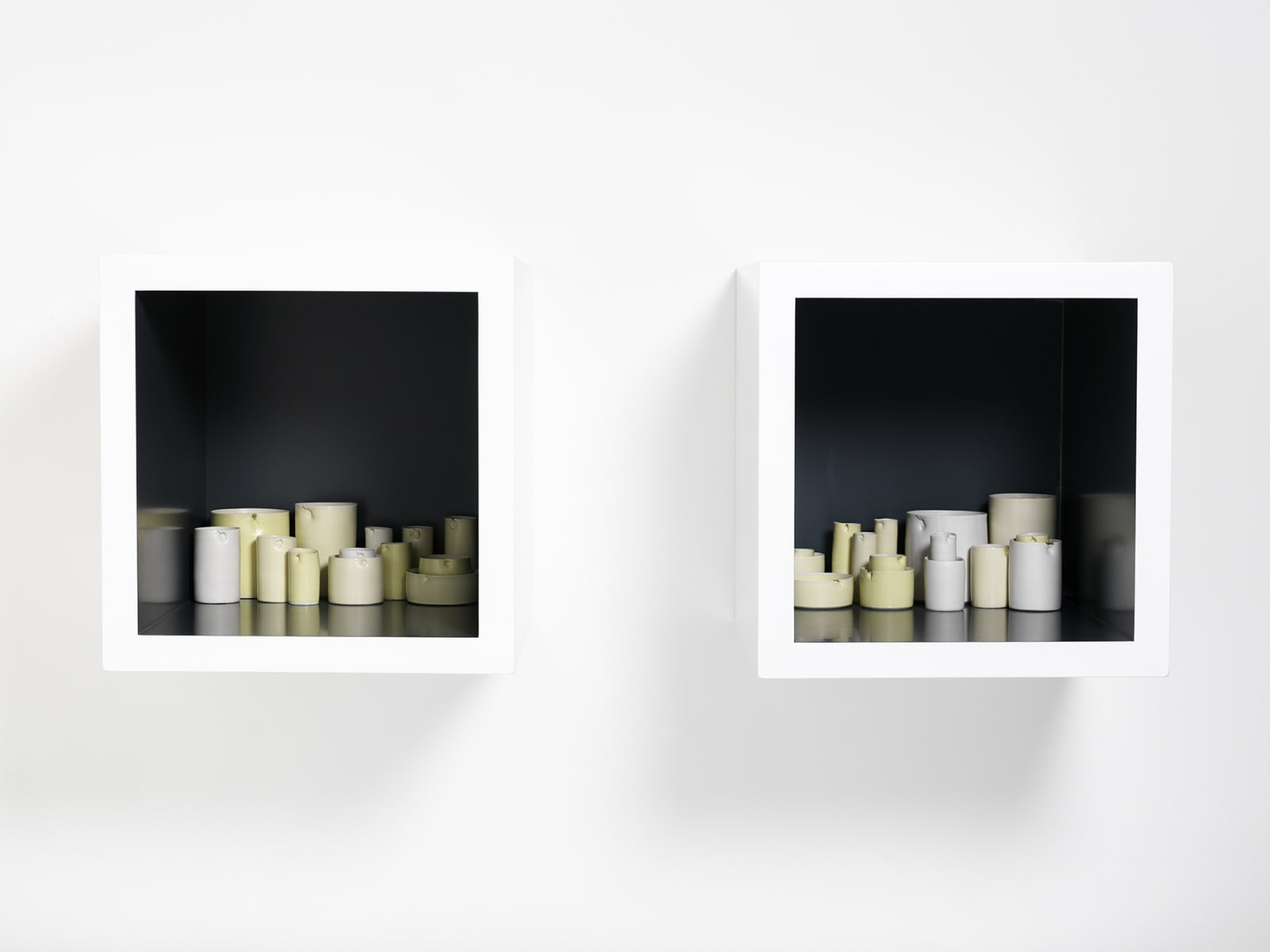 Edmund DE WAAL (b.1964) Aurea, 2007 Two lacquer cabinets containing 28 thrown porcelain vessels in white and yellow glazes with gold leaf Cabinets each 13 ¾ x 13 ¾ x 17 ¾ inches / 35 x 35 x 45 cm
