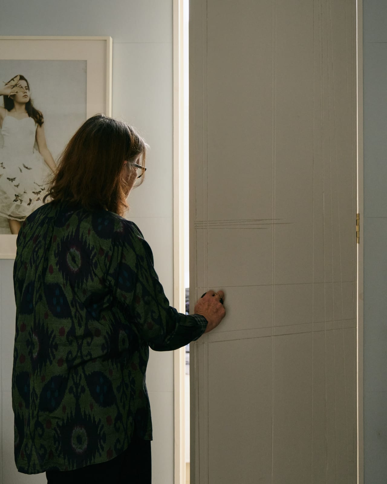 Christine opens the door to the secret guest room that was once Stuarts woodwork bench