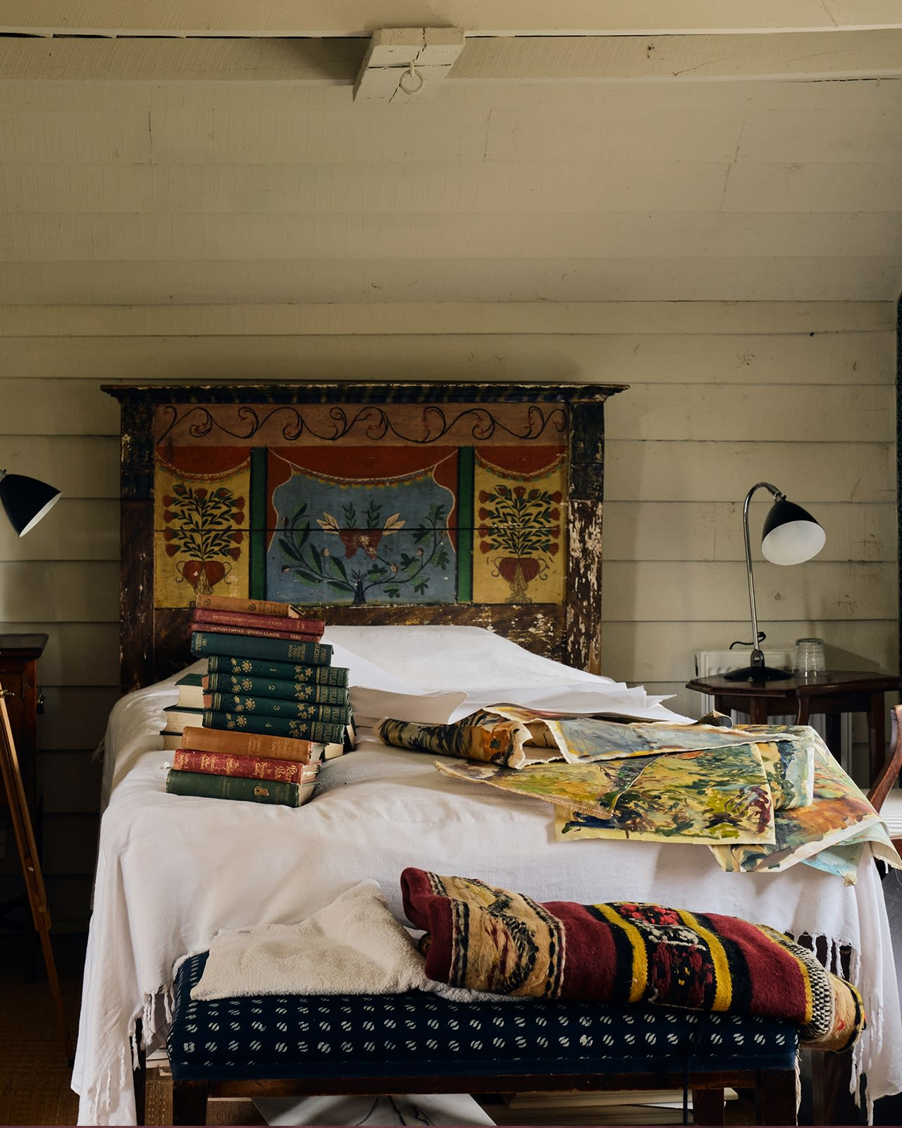 Past works pile up in the guest bedroom at her Wiltshire home.