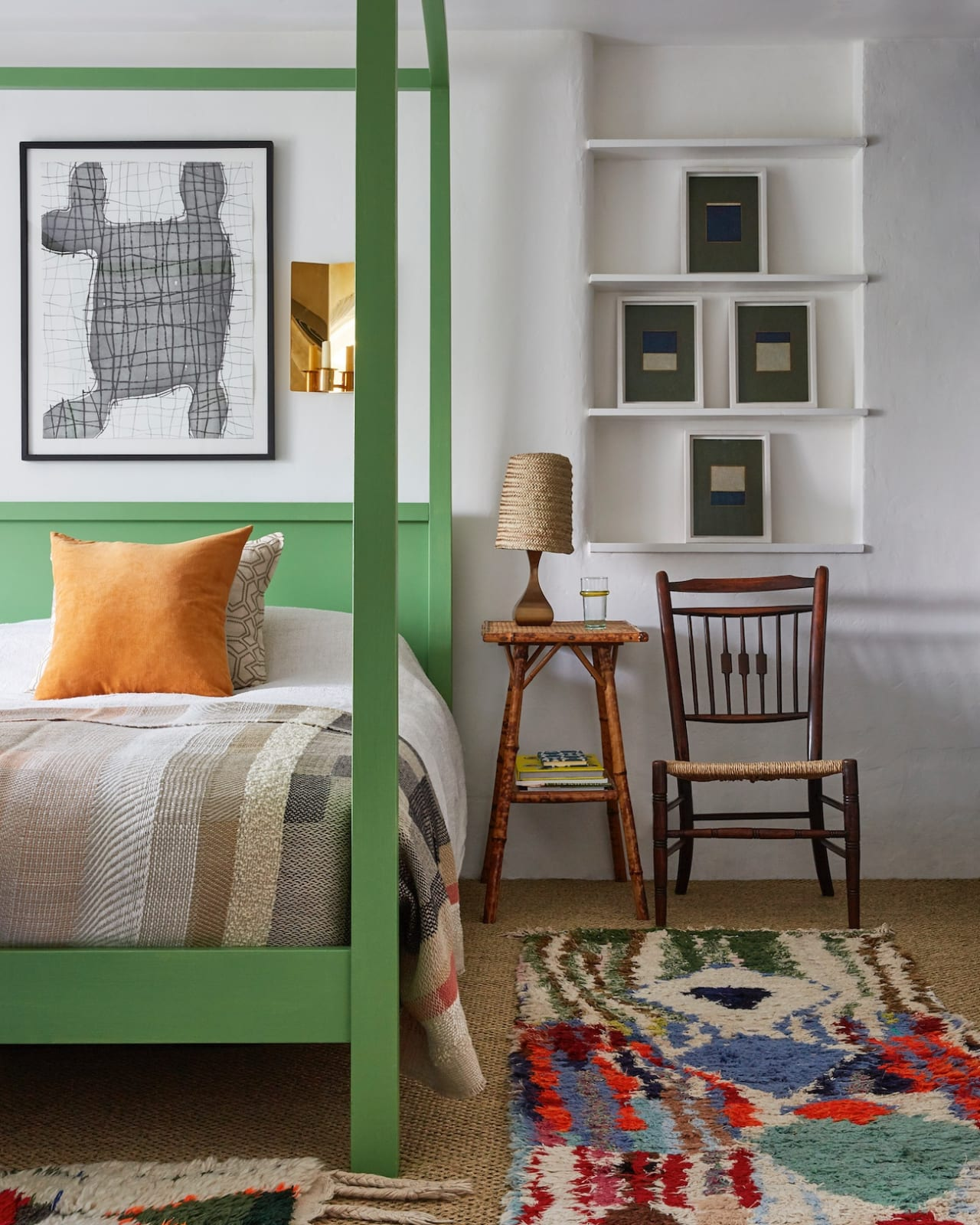 Tobias resides in a Habitat four-poster bed – given a grass green finish – with boucherouite Moroccan rugs on the floor in one of the two bedrooms upstairs.