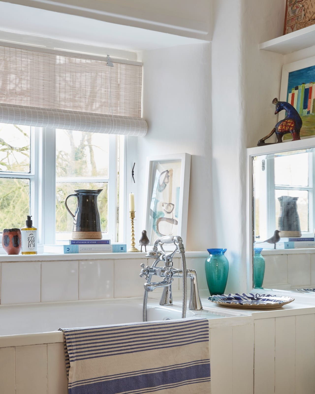 The peaceful bathroom in the cottage that looks out into the garden below.