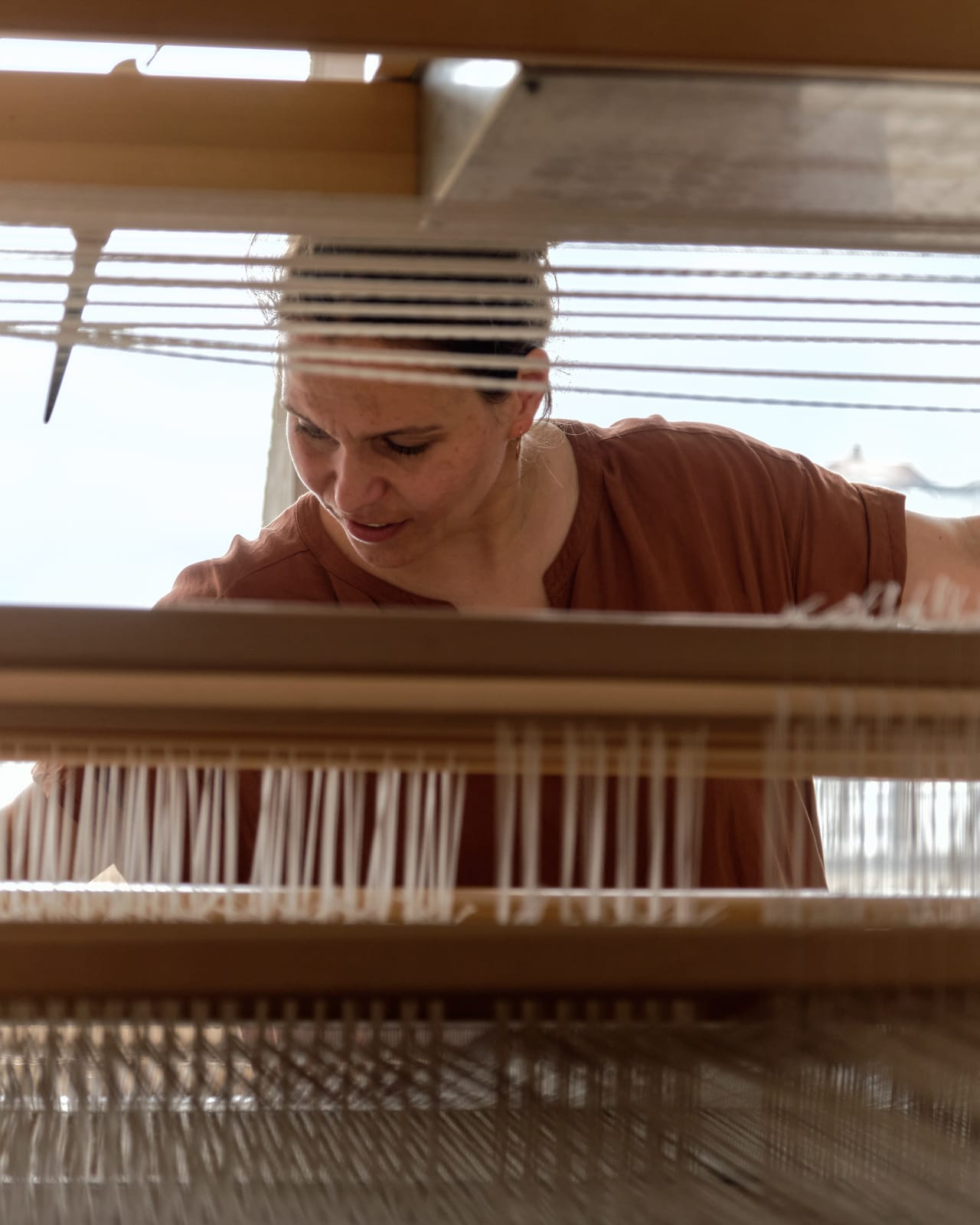 Catarina working at her Finnish-made loom in her studio.