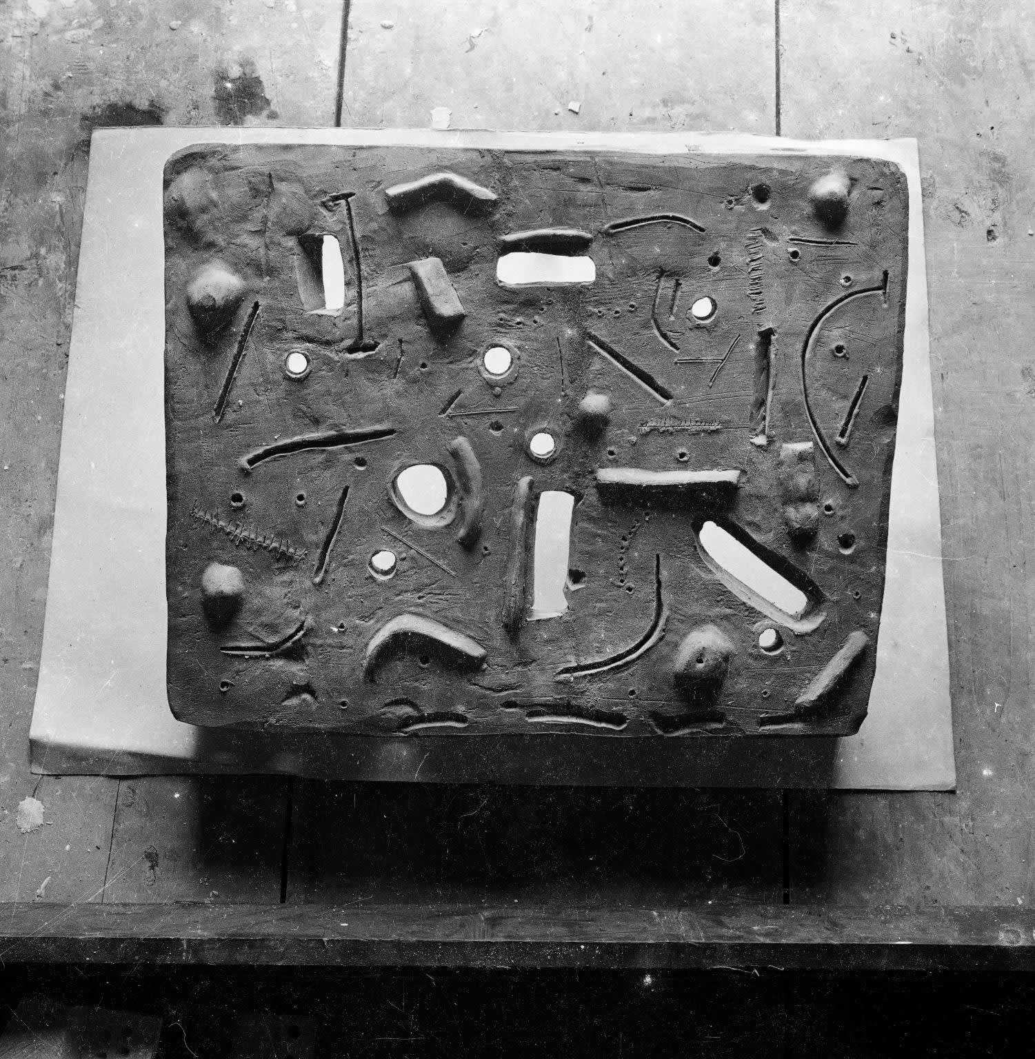 A contemproary photograph of the Relief taken by Nigel Henderson. The Eduardo Paolozzi Foundation. The Estate of Nigel Henderson. Tate Archive