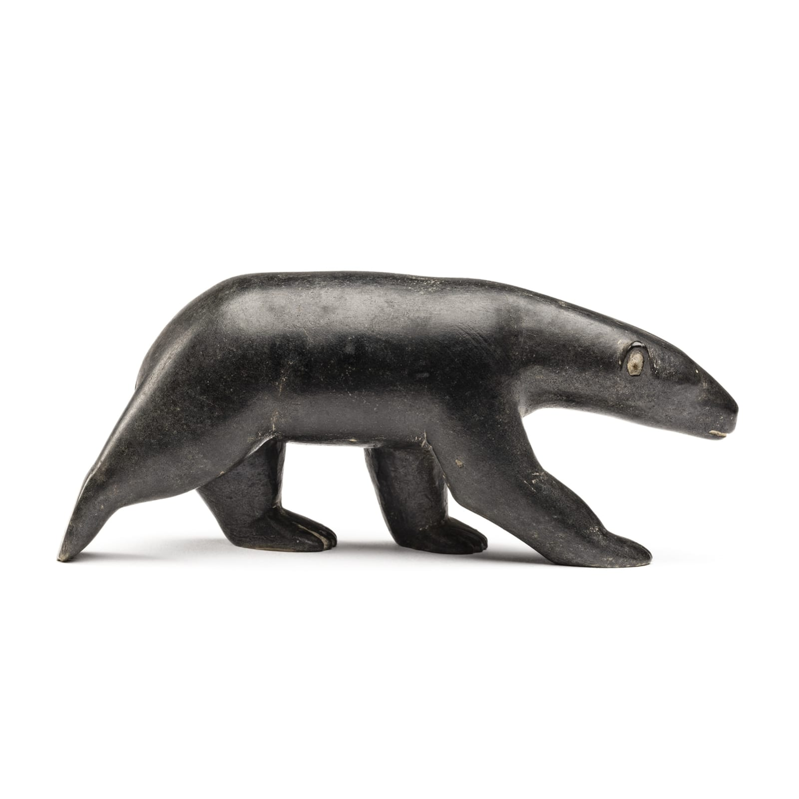 HENRY EVALUARDJUK (1927-2003) IqalUit (Frobisher Bay) Walking Bear, late 1950s REALIZED: $3,120