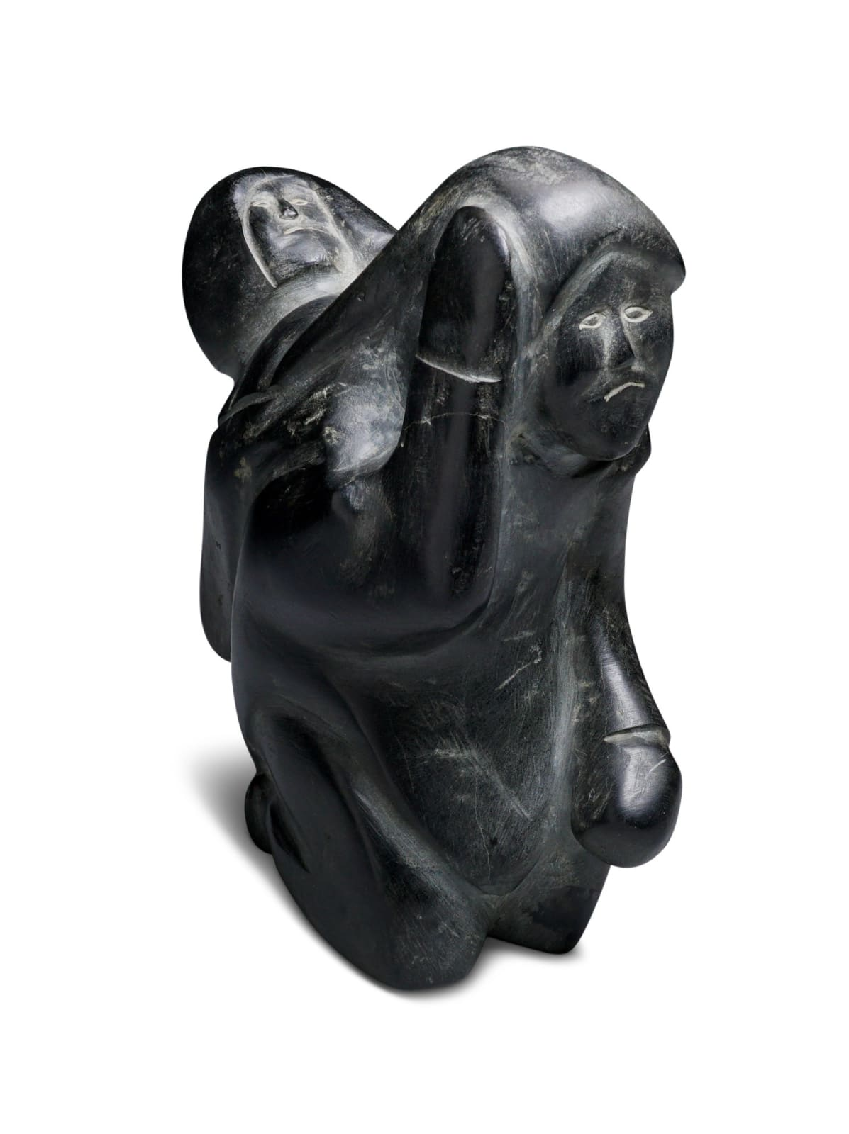 LOT 25 JACOB IRKOK (1937-2009) ARVIAT (ESKIMO POINT) Woeful Mother and Child, 1970 stone, 6 1/2 x 5 x 2 1/2 in (16.5 x 12.7 x 6.3 cm) ESTIMATE: $400 — $600