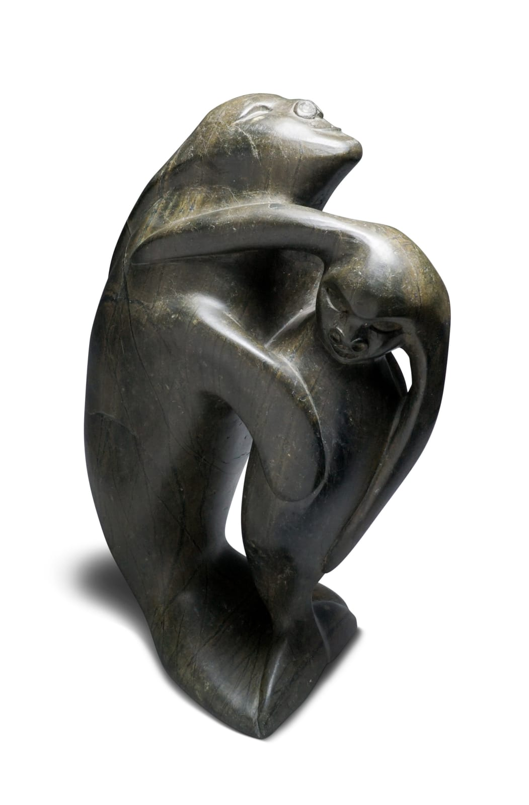 LOT 2 OSUITOK IPEELEE, R.C.A. (1923-2005) KINNGAIT (CAPE DORSET) Swimming Sedna With Her Child, c. 1970s stone, 16 x 10 x 6 in (40.6 x 25.4 x 15.2 cm) ESTIMATE: $2,500 — $3,500 PRICE REALIZED: $1,800