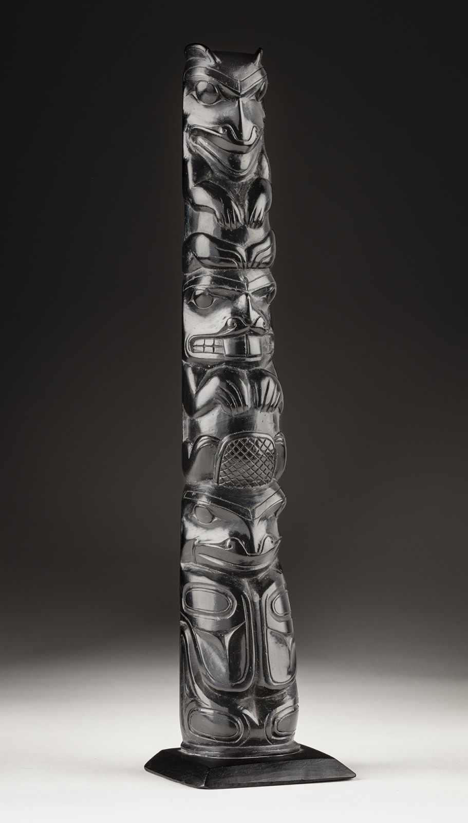 Lot 55 UNIDENTIFIED ARTIST, HAIDA, PROBABLY MASSET, HAIDA GWAII Totem Pole, c. 1900-1910 argillite, 9.5 x 2.5 x 2 in (24.1 x 6.3 x 5.1 cm) Estimate: $1,800⁠ — $2,800 Price realized: $4,560