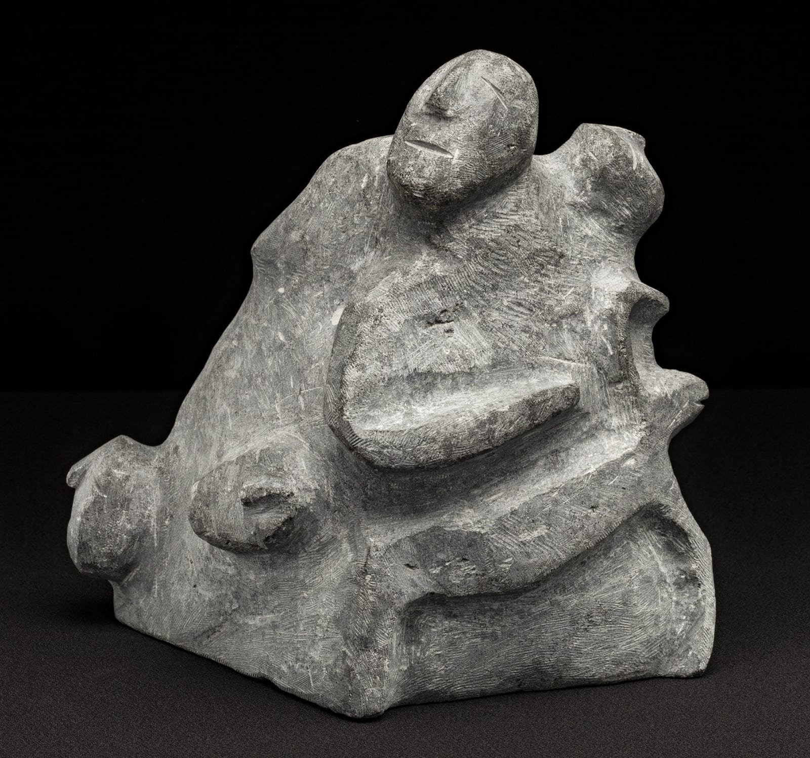 Lot 31 MARY AYAQ ANOWTALIK (1938-) ARVIAT (ESKIMO POINT) Composition with People and Caribou, 2004 stone, 9 x 7 x 8.5 in (22.9 x 17.8 x 21.6 cm) Estimate: $3,500 — $5,000