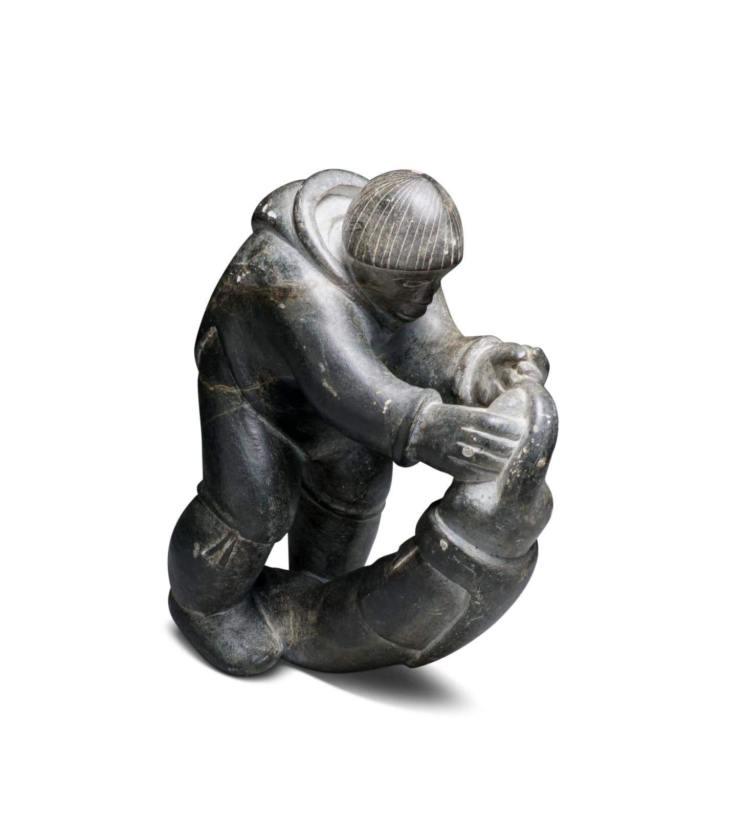 LEVI QUMALUK (1919-1997) PUVIRNITUQ (POVUNGNITUK) Hunter with Seal, early-mid 1960s stone, 8 1/4 x 6 1/2 x 3 1/2 in (21 x 16.5 x 8.9 cm) ESTIMATE: $800 — $1,200 NEW PRICE: $600