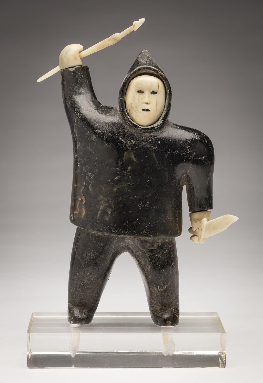 Lot 4 AKEEAKTASHUK (1898-1954) m., INUKJUAK (PORT HARRISON) Standing Hunter, c. 1950-51 stone and ivory, 5.75 x 3.25 x 2 in (14.6 x 8.3 x 5.1 cm) without base Estimate: $5,000 — $8,000