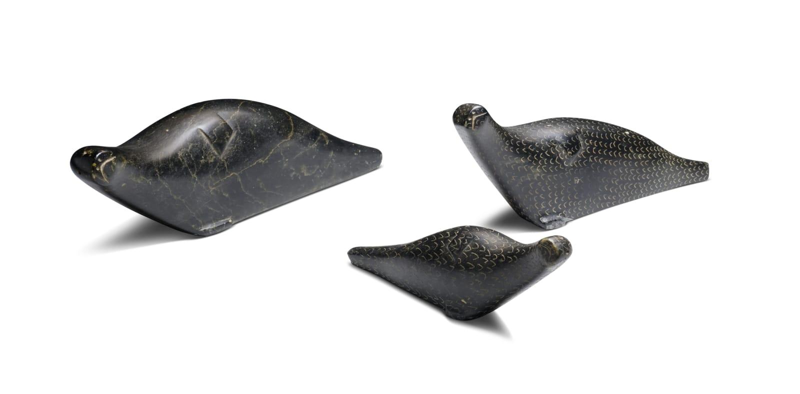 NINGEOSEAK PETER (1937-) KINNGAIT (CAPE DORSET) Three Basking Seals, 1963 each stone, largest: 2 1/2 x 8 1/4 x 1 1/2 in (6.3 x 21 x 3.8 cm) and smaller ESTIMATE: $600 — $900 New Price: $400