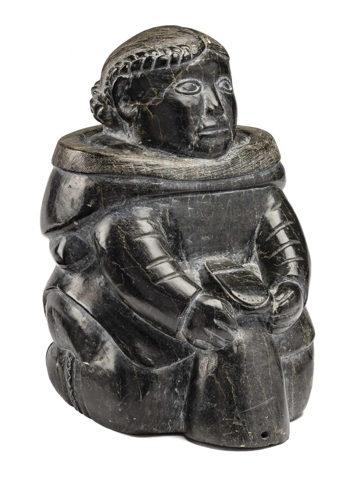 Lot 102 SARAH MEEKO NASTAPOKA (1925-d) INUKJUAK (PORT HARRISON Kneeling Woman Mending A Kamik, c. early 1960s stone, 12.5 x 7.25 x 9.5 in (31.8 x 18.4 x 24.1 cm) Estimate: $6,000— $9,000