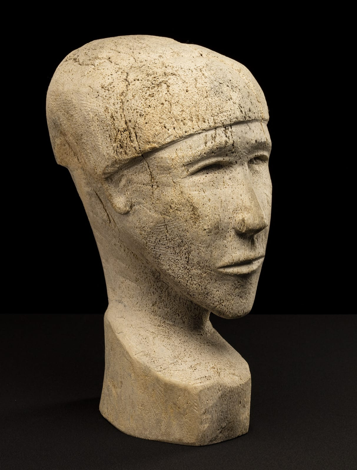Lot 108 PAULOOSIE KAKEE (1933-) PANNIQTUUQ (PANGNIRTUNG) Portrait Bust of a Young Man, 1968 whale bone, 16 x 6.5 x 8.75 in (40.6 x 16.5 x 22.2 cm) Estimate: $1,000⁠⁠⁠— $1,500