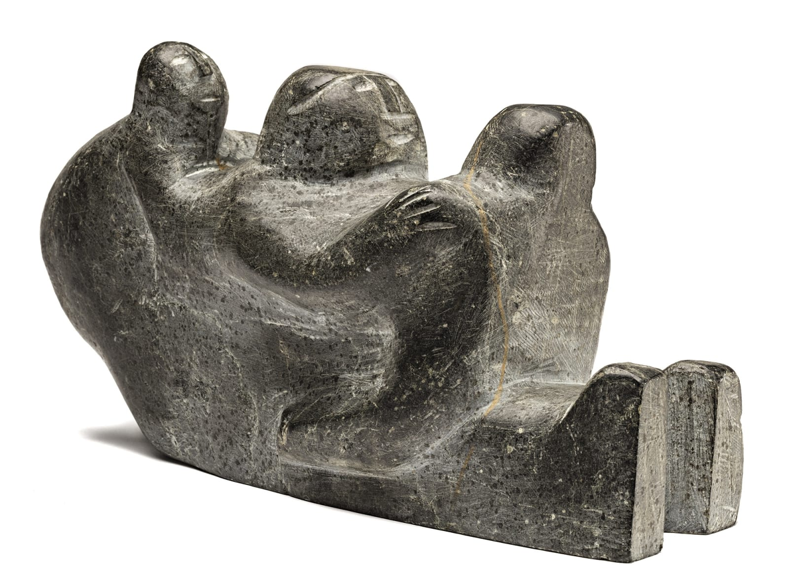 Lot 112 AUGUSTIN ANAROSUK (1917-1976) ARVIAT (ESKIMO POINT) Seated Mother Holding Her Two Children, mid-late 1960s stone, 6 x 11.25 x 4.25 in (15.2 x 28.6 x 10.8 cm) Estimate: $1,200⁠⁠⁠— $1,800