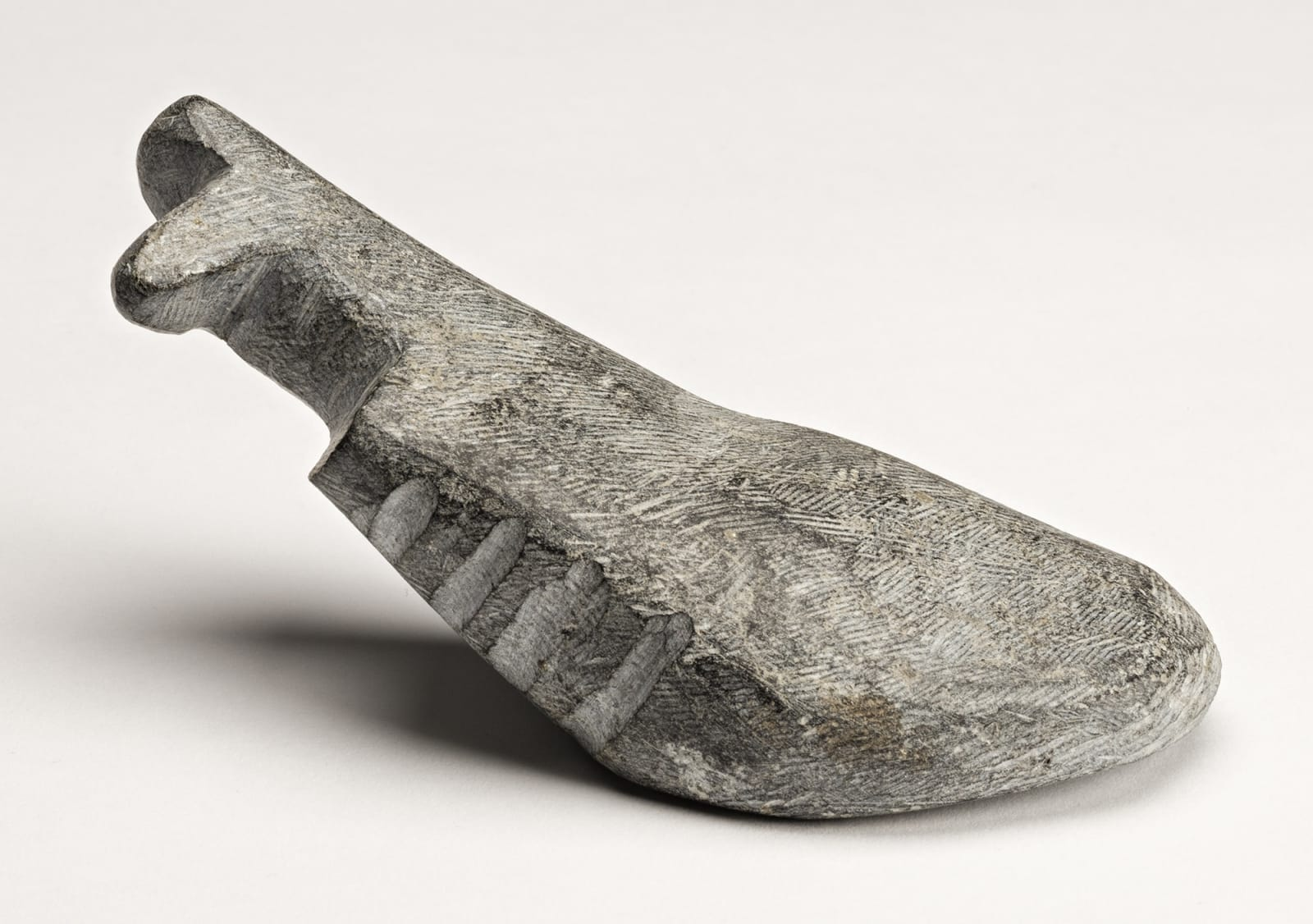 Lot 115 ANDY MIKI (1918-1983) ARVIAT (ESKIMO POINT) Reclining Animal, early-mid 1970s stone, 2.25 x 5.5 x 2 in (5.7 x 14 x 5.1 cm) Estimate: $1,800— $2,800 price realized: $3,600