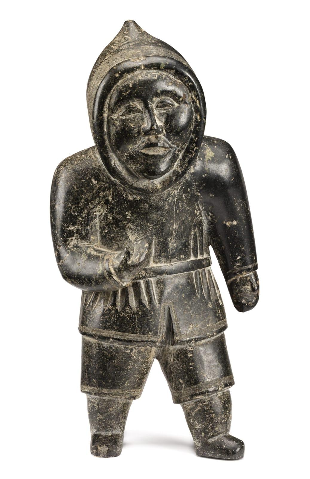 Lot 22 NIVIAQSI (NIVIAKSIAK) (1908-1959) m., KINNGAIT (CAPE DORSET) Standing Hunter, c. 1955 stone, 15 x 7.5 x 9.25 in (38.1 x 19.1 x 23.5 cm) Estimate: $12,000 — $18,000 PRICE REALIZED: $26,400