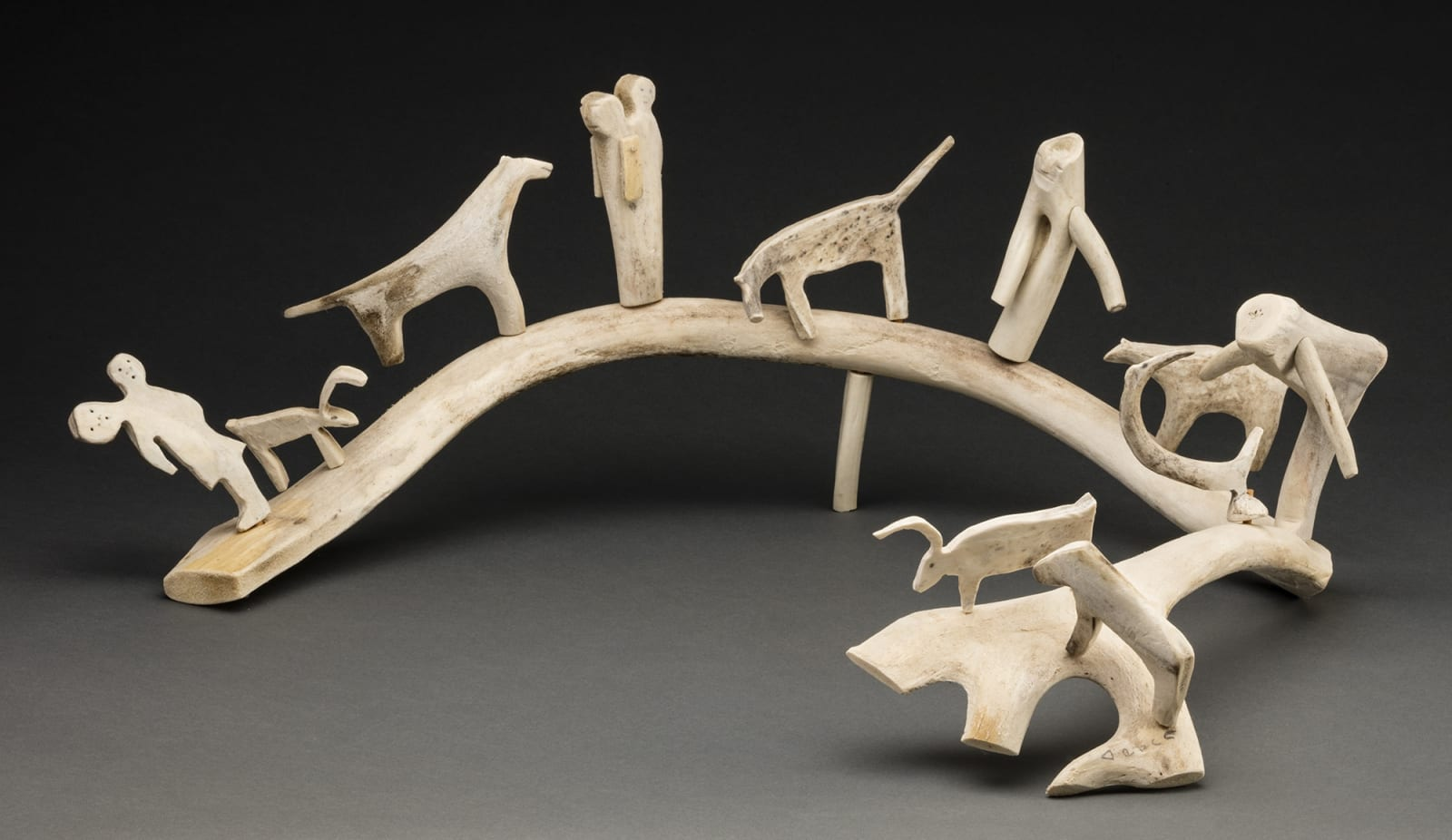 Lot 28 LUKE ANOWTALIK (1932-2006) ARVIAT (ESKIMO POINT) Composition with People and Animals, 2005 antler, graphite, sinew, and wood, 8.75 x 28.5 x 19.5 in (22.2 x 72.4 x 49.5 cm) Estimate: $6,000 — $9,000