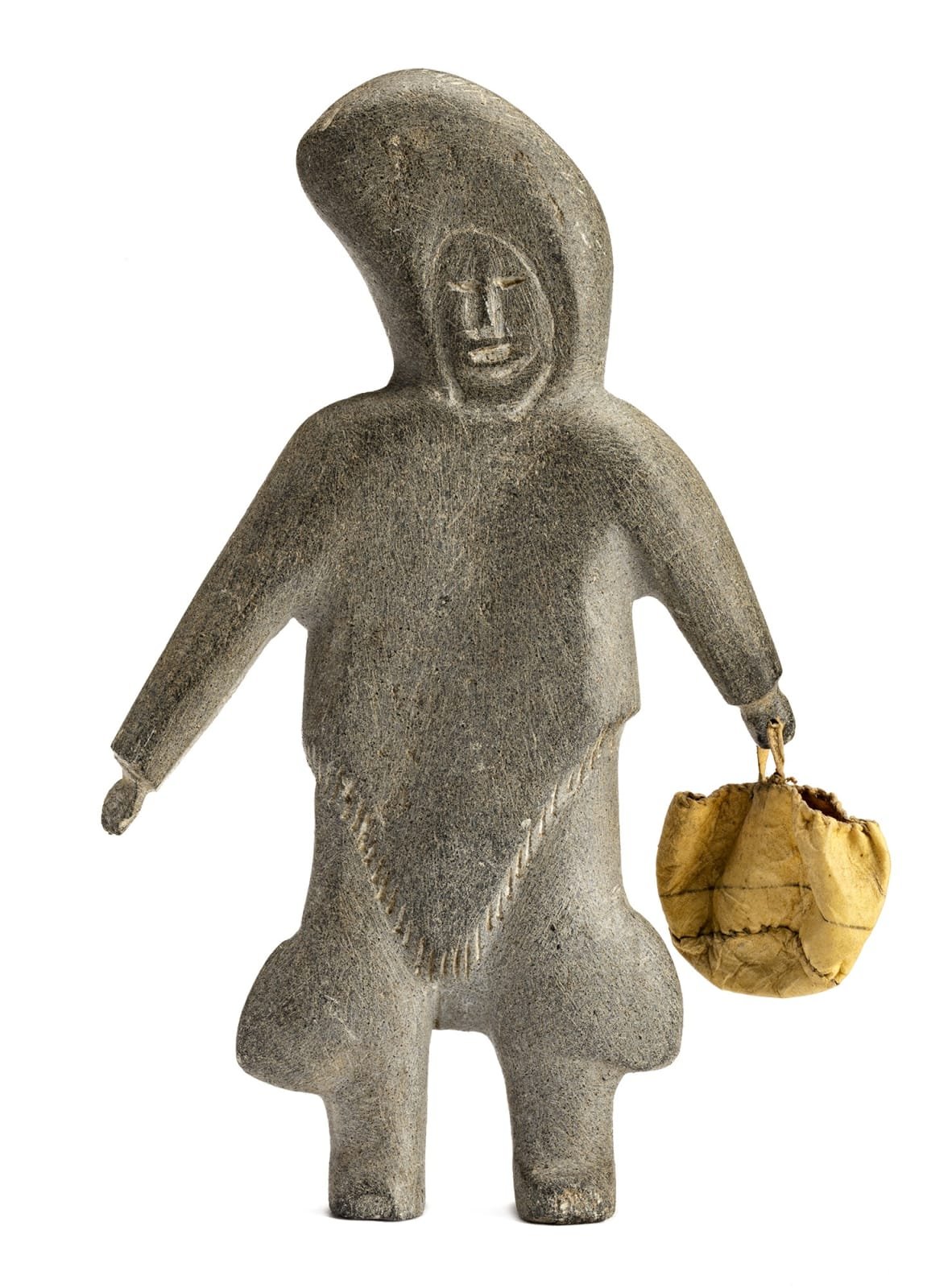 Lot 29 MARGARET UYAUPERQ ANIKSAK (1905-1993) ARVIAT (ESKIMO POINT) Standing Woman with Skin Bag, c. 1967-68 stone, skin, and sinew, 8.25 x 4.75 x 1.25 in (21 x 12.1 x 3.2 cm) Estimate: $1,200 — $1,800