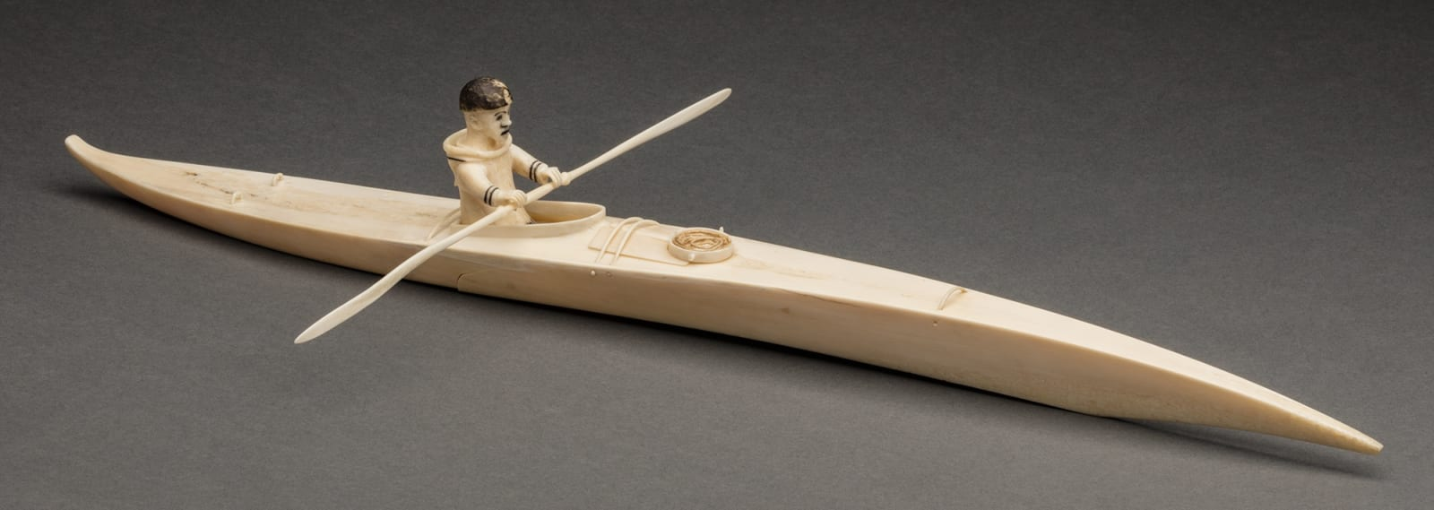 Lot 32 Possibly SHEOKJUK OQUTAQ (1920-1982) m., KIMMIRUT/KINNGAIT (LAKE HARBOUR/CAPE DORSET) Kayaker, c. mid 1930s to 1940s ivory, rope, black ink and inlay, 3 x 18.5 x 9.5 in (7.6 x 47 x 24.1 cm) Estimate: $1,800 — $2,800 Price realized: $1,800