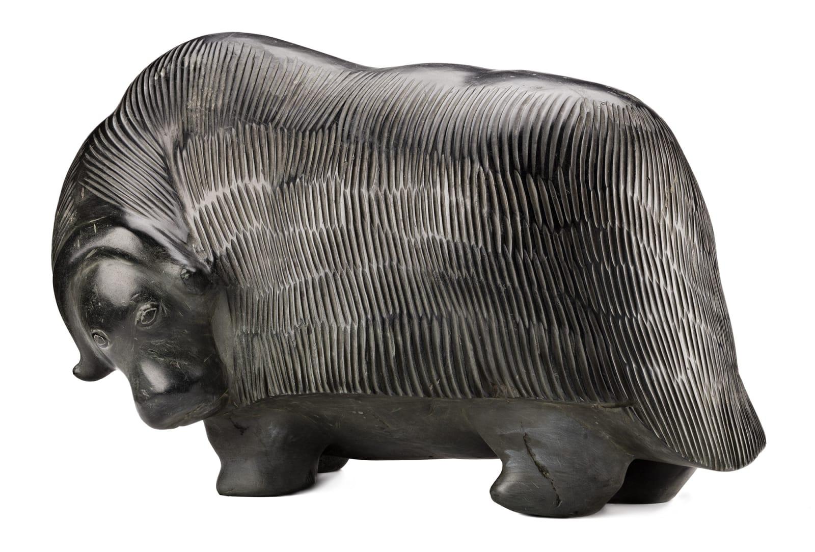 Lot 37 BARNABUS ARNASUNGAAQ (1924-2017) QAMANI'TUAQ (BAKER LAKE) Muskox, 1973 stone, 14.75 x 25 x 13.5 in (37.5 x 63.5 x 34.3 cm) Estimate: $60,000 — $80,000