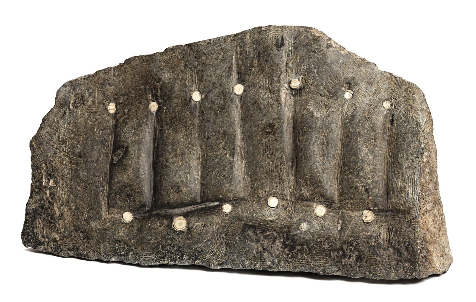 Lot 41 ELIZABETH NUTARAALUK AULATJUT (1914-1998) ARVIAT (ESKIMO POINT) Six Faces, late 1980s stone and antler, 12 x 21 x 5 in (30.5 x 53.3 x 12.7 cm) Estimate: $10,000 — $15,000