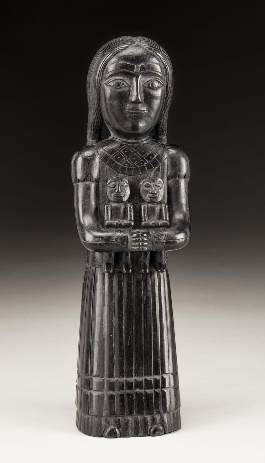 Lot 51 UNIDENTIFIED ARTIST, HAIDA Female Figure Holding Two Dolls, c. 1840-1860 argillite, 10.75 x 3.25 x 2.25 in (27.3 x 8.3 x 5.7 cm) Estimate: $18,000 — $28,000