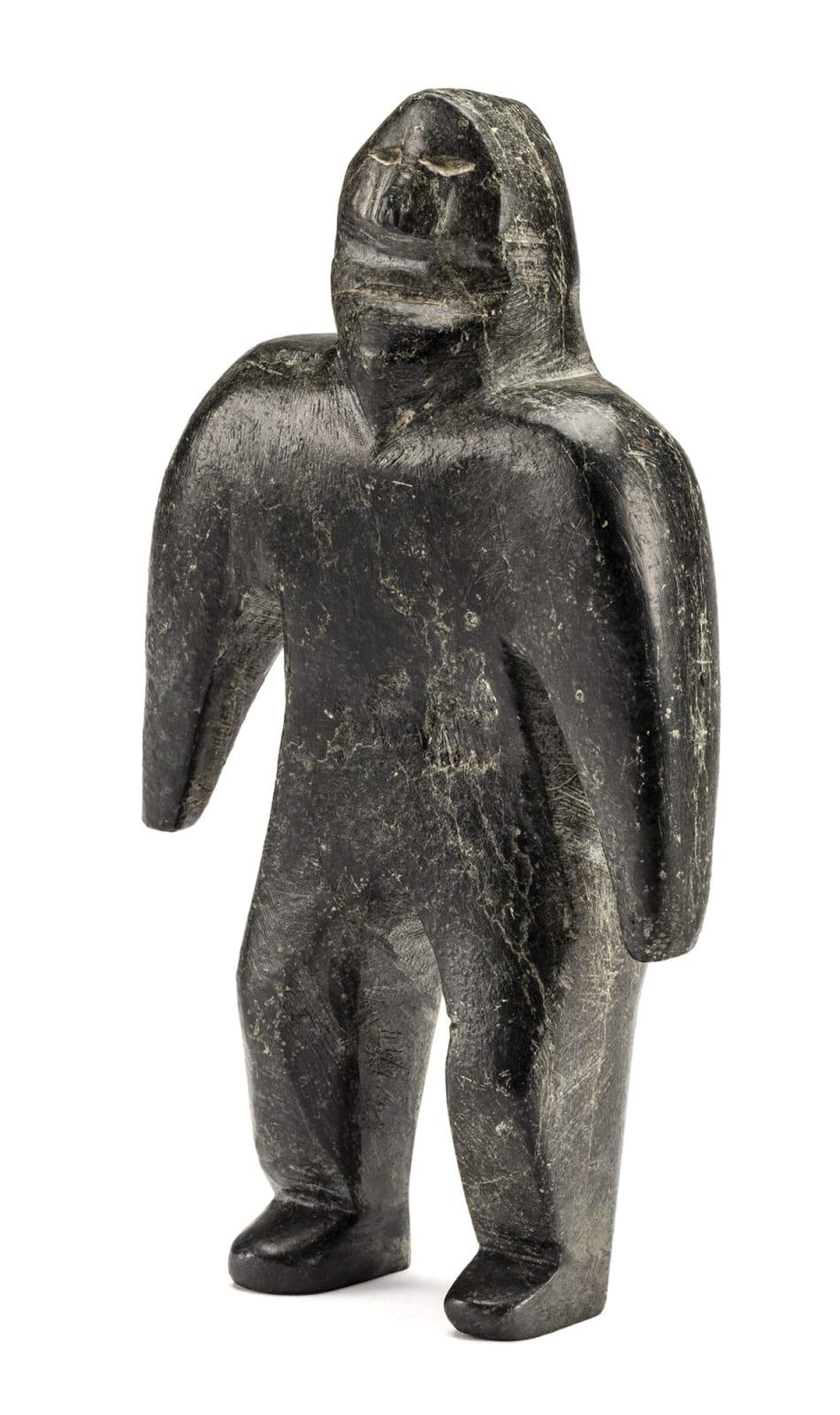 Lot 57 JOHN KAVIK (1897-1993) KANGIQLINIQ (RANKIN INLET) Standing Man, 1973 stone, 8.25 x 4.5 x 1.25 in (21 x 11.4 x 3.2 cm) Estimate: $4,000 — $6,000 Price realized: $3,840