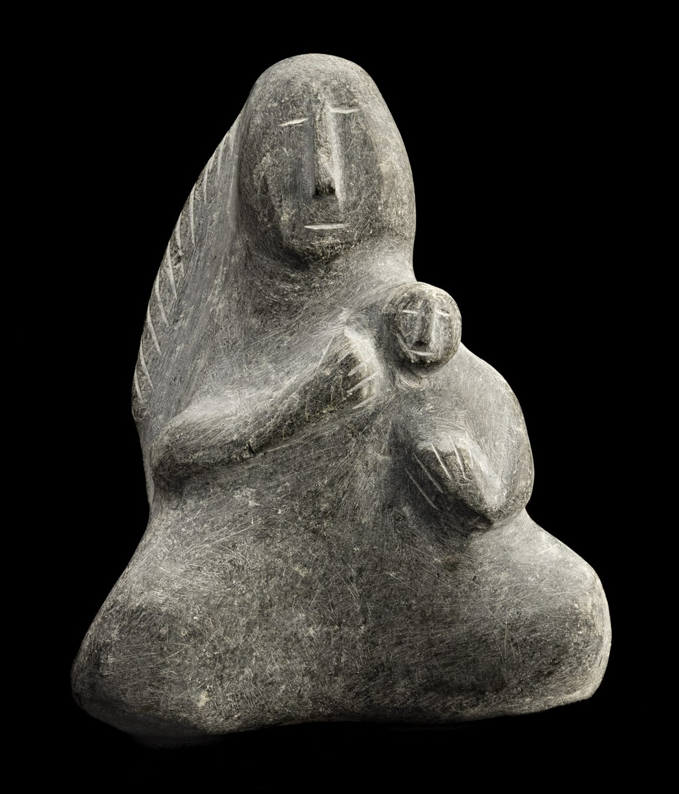 Lot 59 ELIZABETH NUTARAALUK AULATJUT (1914-1998), ARVIAT (ESKIMO POINT) Mother and Child, c. 1970-72 stone, 8 x 6.5 x 3 in (20.3 x 16.5 x 7.6 cm) Estimate: $6,000⁠ — $9,000 Price Realized: $6,160
