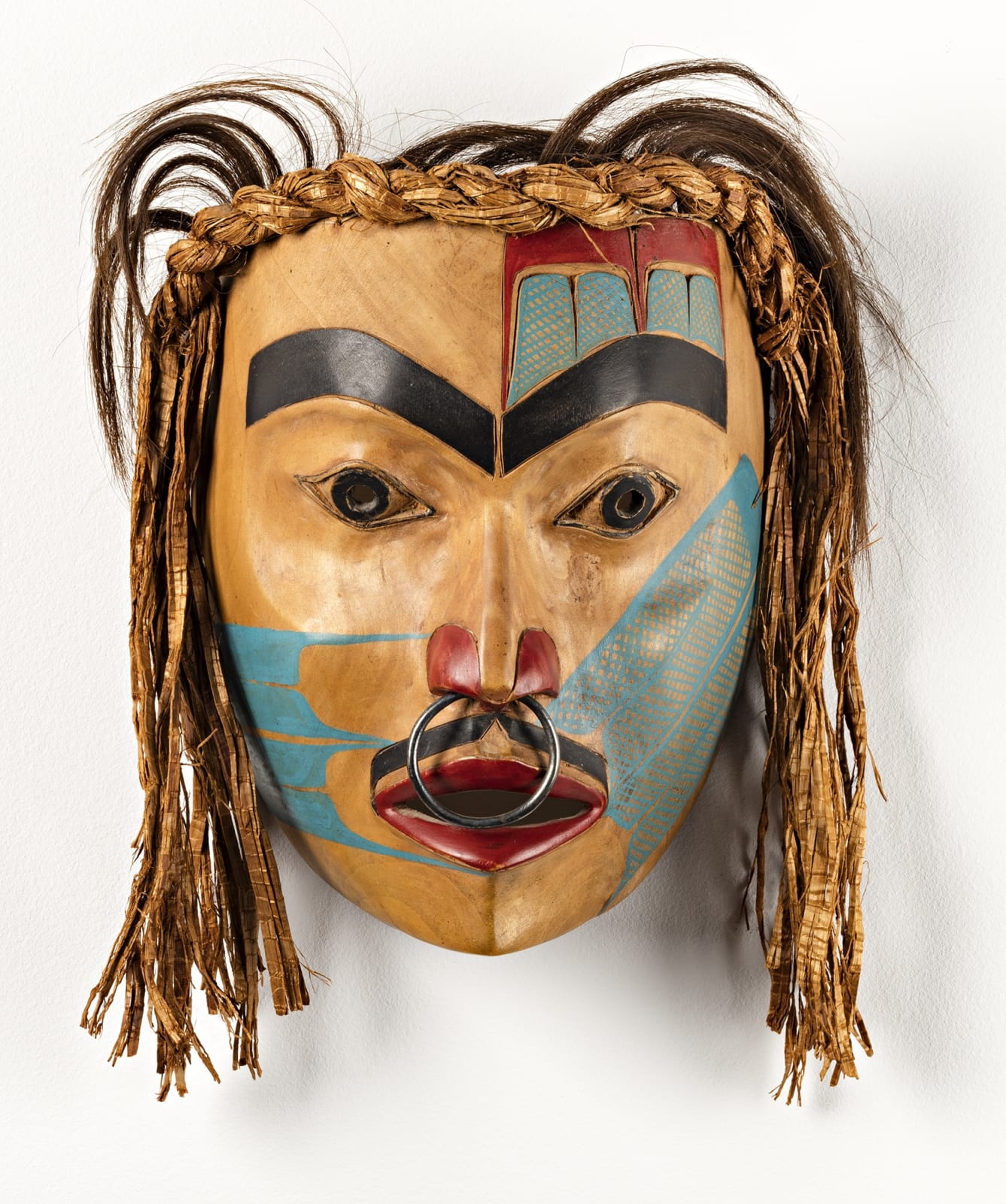 Lot 69 FREDA DIESING (1925-2002), HAIDA, PRINCE RUPERT Portrait Mask, 1971 alder, cedar bark, hair, metal, and paint, 8 x 6 x 4.5 in (20.3 x 15.2 x 11.4 cm) excluding hair Estimate: $5,000⁠ ⁠— $7,000