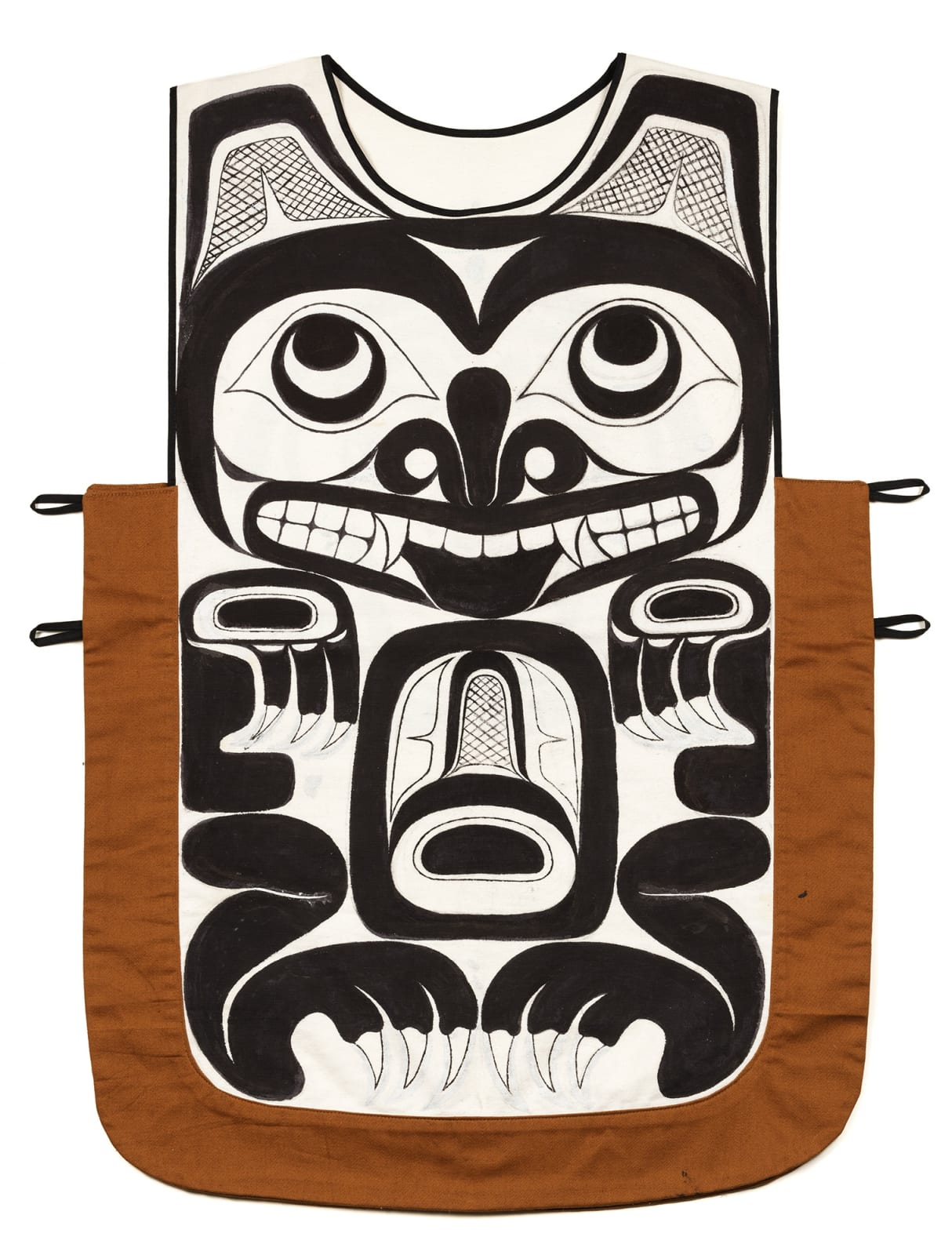 Lot 73 BILL REID, O.B.C., R.C.A. (1920-1998) Painted Canoe Tunic, 1989 pigment on a hand-sewn fabric tunic, 35.25 x 27 in (89.5 x 68.6 cm) Estimate: $10,000 — $15,000 Price realized: $15,600