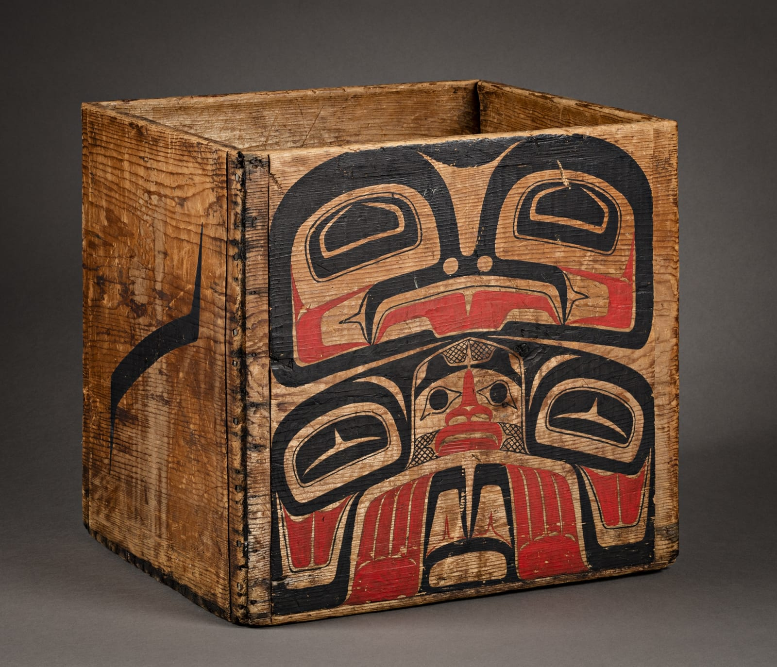 Lot 76 UNIDENTIFIED GITXSAN (GITKSAN) MAKER AND EARL MULDON (MULDOE), O.C. (1936-), GITXSAN (GITKSAN) Bentwood Box, c. late 19th century wood with later added painting by Earl Muldon in 1972, 16 x 14 x 15 in (40.6 x 35.6 x 38.1 cm) Estimate: $2,000— $3,000 Price realized: $2,640