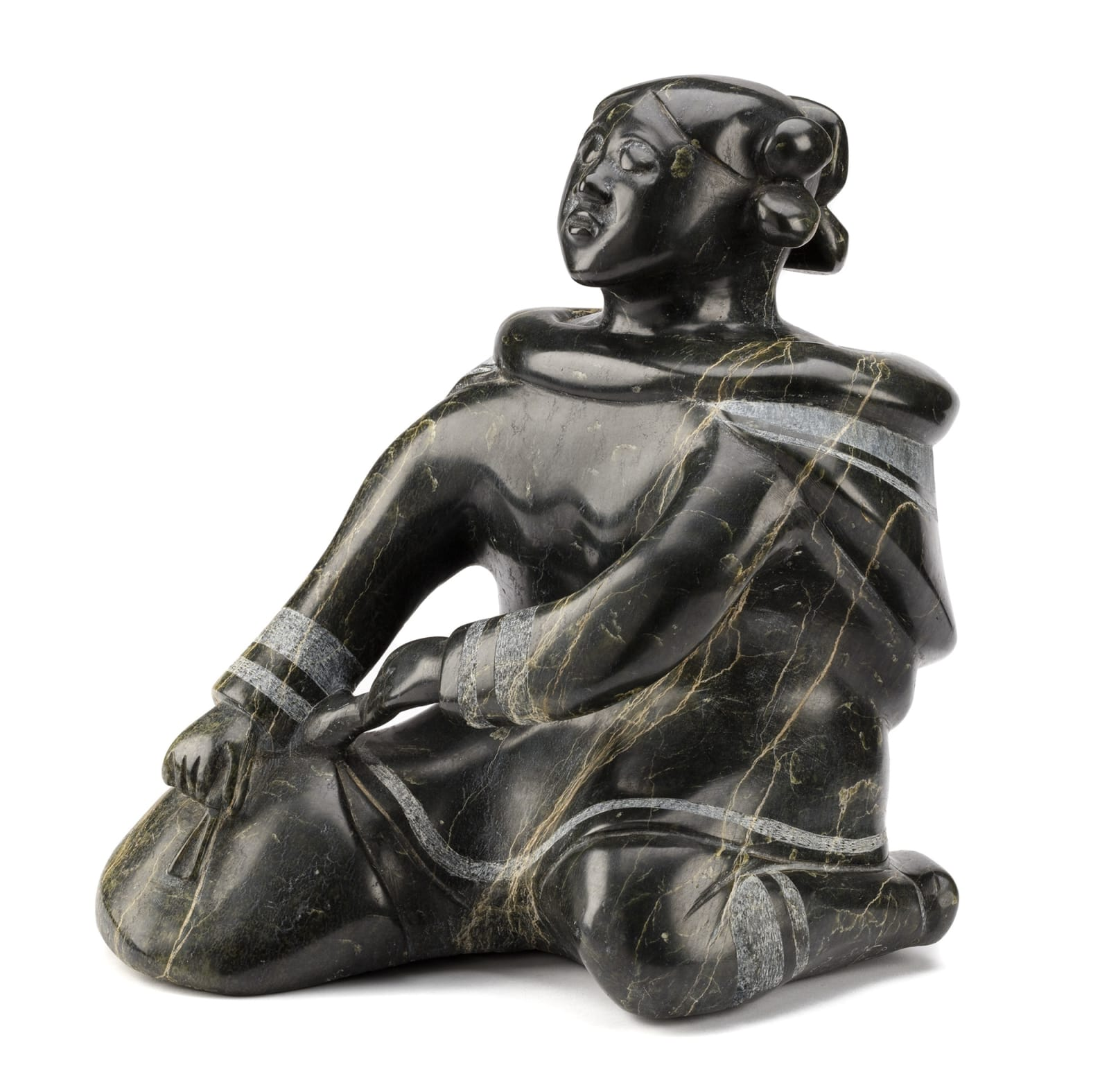 Lot 80 OSUITOK IPEELEE, R.C.A. (1923-2005) m., KINNGAIT (CAPE DORSET) Kneeling Woman Scraping a Skin, c. 1970 stone, 14.5 x 13 x 14.5 in (36.8 x 33 x 36.8 cm) Estimate: $25,000— $35,000 Price realiZed: $72,000