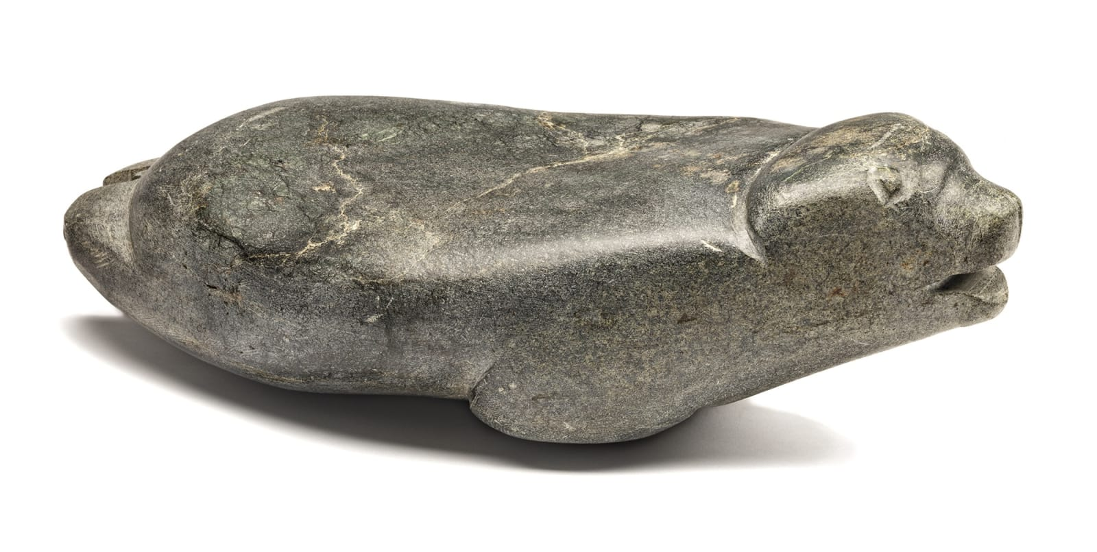 Lot 83 JOHN KAVIK (1897-1993), KANGIQLINIQ (RANKIN INLET) Seal, 1967 stone, 5.25 x 17.25 x 8.5 in (13.3 x 43.8 x 21.6 cm) Estimate: $6,000⁠⁠⁠— $9,000 Price realized: $5,760