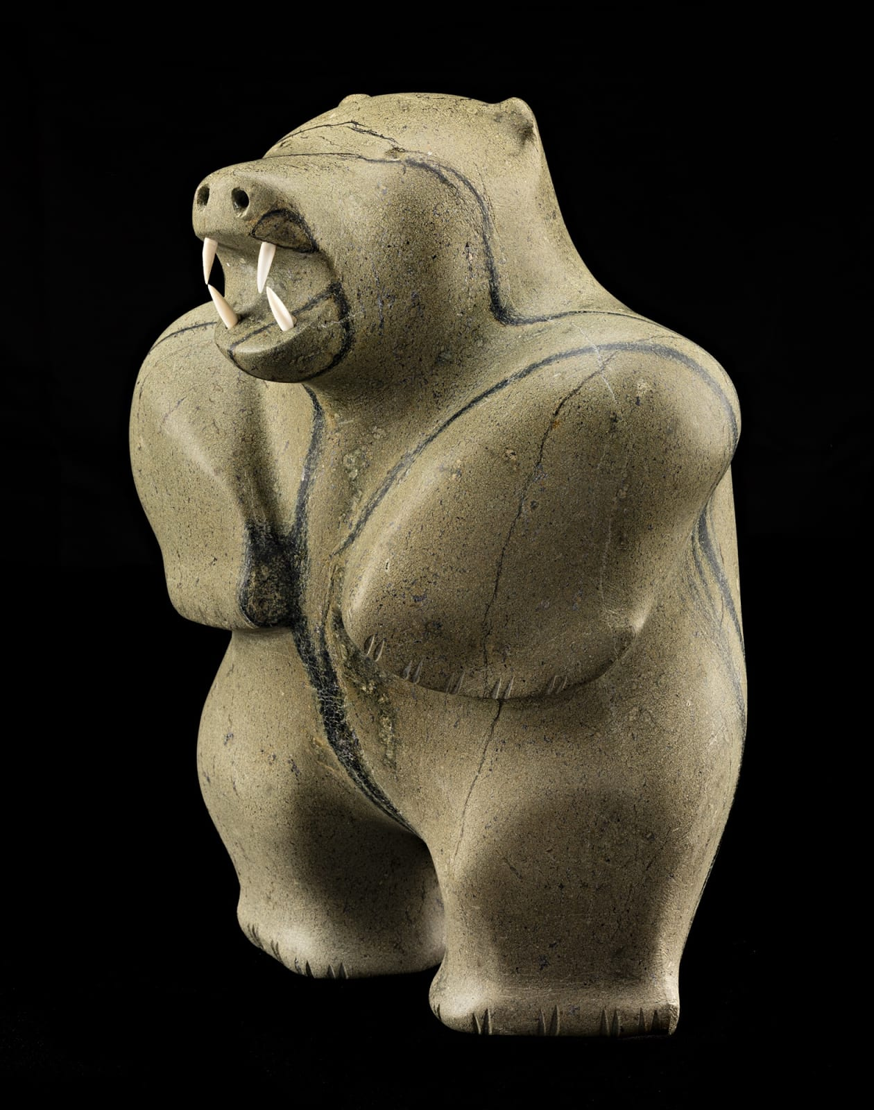 Lot 88 PAUTA SAILA, R.C.A. (1916-2009) m., KINNGAIT (CAPE DORSET) Standing Polar Bear, early 1970s stone and ivory, 12 x 8.75 x 9 in (30.5 x 22.2 x 22.9 cm) Estimate: $20,000⁠⁠⁠— $30,000 Price realized: $20,400