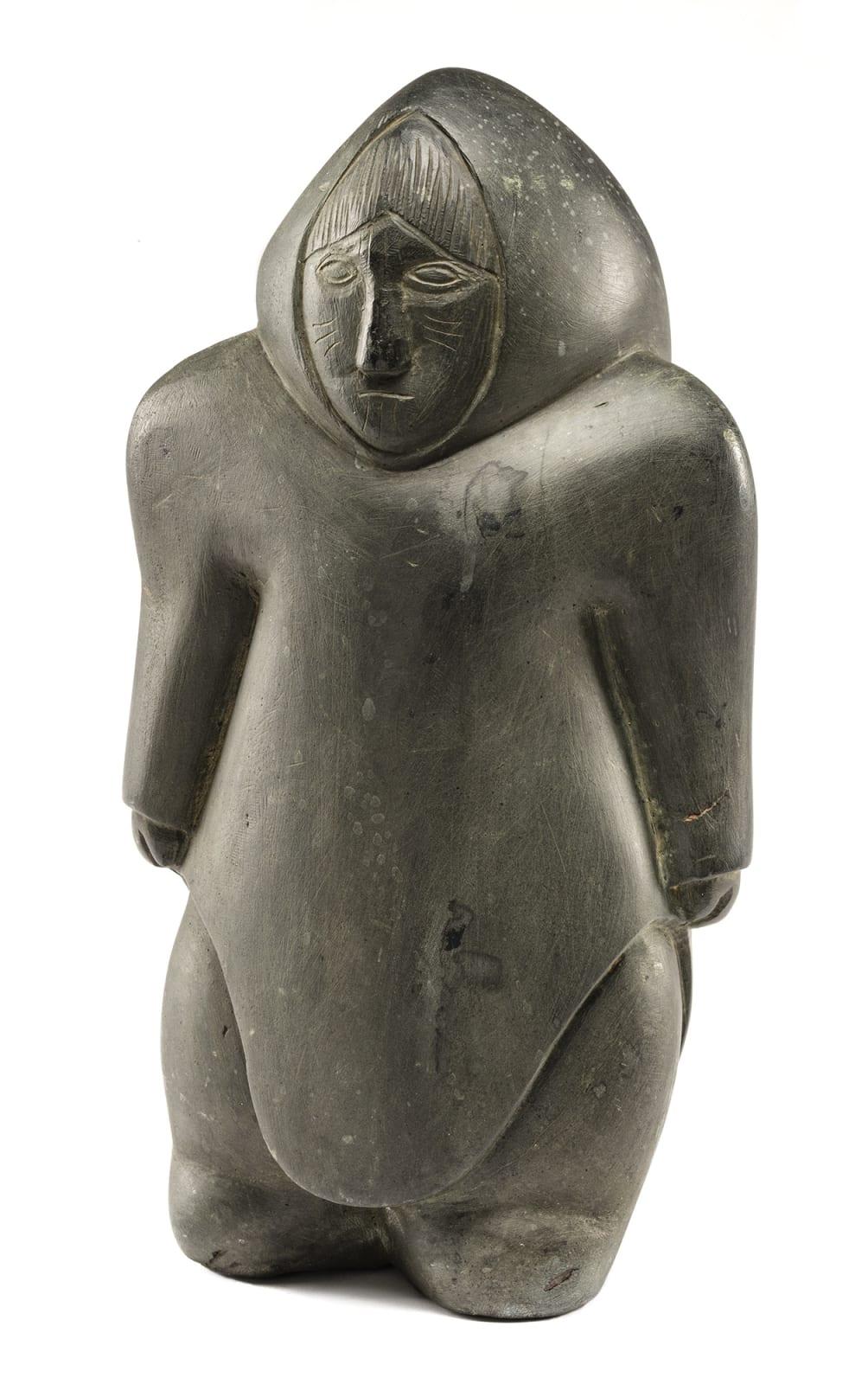 Lot 9 EFFIE ANGALI'TAAQ ARNALUAQ (1936-), QAMANI'TUAQ (BAKER LAKE) Standing Woman with Tattooed Face, c. 1983-84 stone, 14.5 x 7.5 x 7.5 in (36.8 x 19.1 x 19.1 cm) Estimate: $9,000 — $12,000