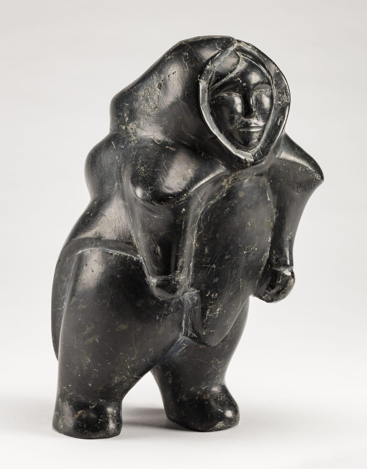 Lot 97 DOMINIC KINGILIK (1939-1990), QAMANI'TUAQ (BAKER LAKE) Walking Woman, 1964 stone, 10.5 x 6 x 6 in (26.7 x 15.2 x 15.2 cm) ESTIMATE: $3,500— $5,000 PRICE REALIZED: $3,360