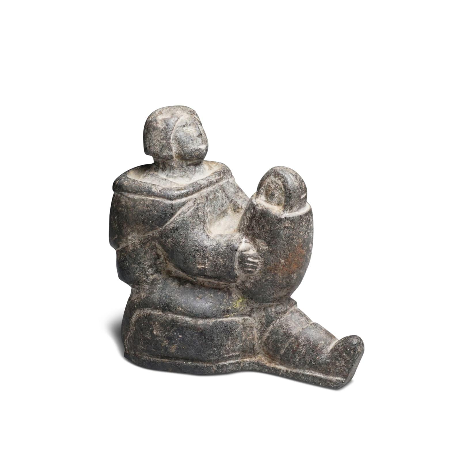 Possibly: MIAIJI UITANGI USAITAIJUK (1911-D), SALLUIT (SUGLUK) Mother Holding Her Swaddled Child, late 1950s stone, 5 x 2 1/2 x 4 1/2 in (12.7 x 6.3 x 11.4 cm) ESTIMATE: $500 — $700 New Price: $300