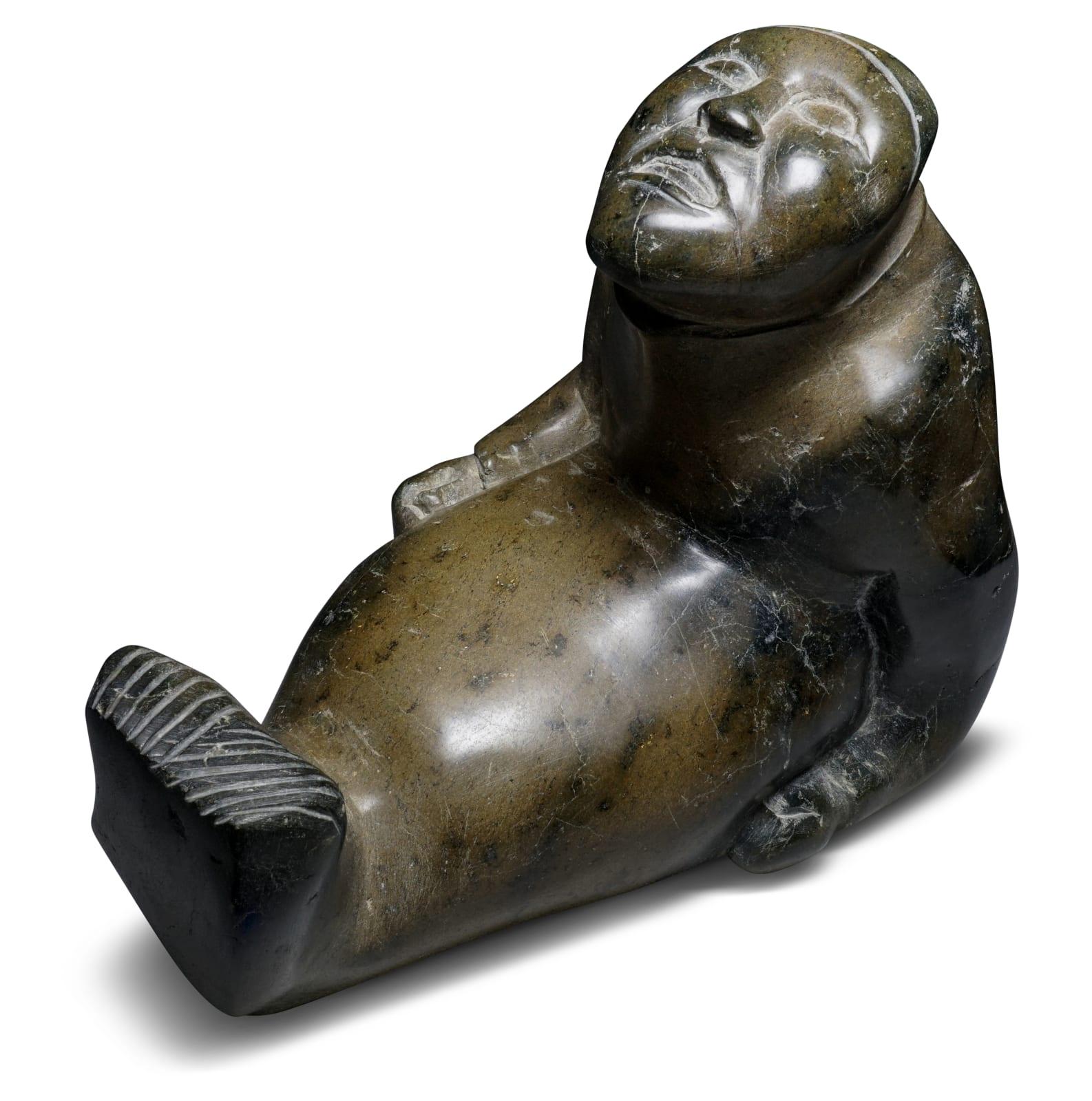 Possibly: TAYARAQ TUNNILLIE (1934-2015) KINNGAIT (CAPE DORSET) Shaman Seal Transformation stone, 12 3/4 x 9 x 14 in (32.4 x 22.9 x 35.6 cm) ESTIMATE: $2,000 — $3,000 New Price: $1,600