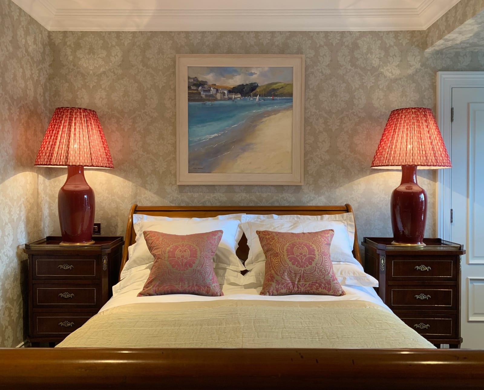 A relaxing coastal themed painting by Jane Lampard for this classic bedroom scheme