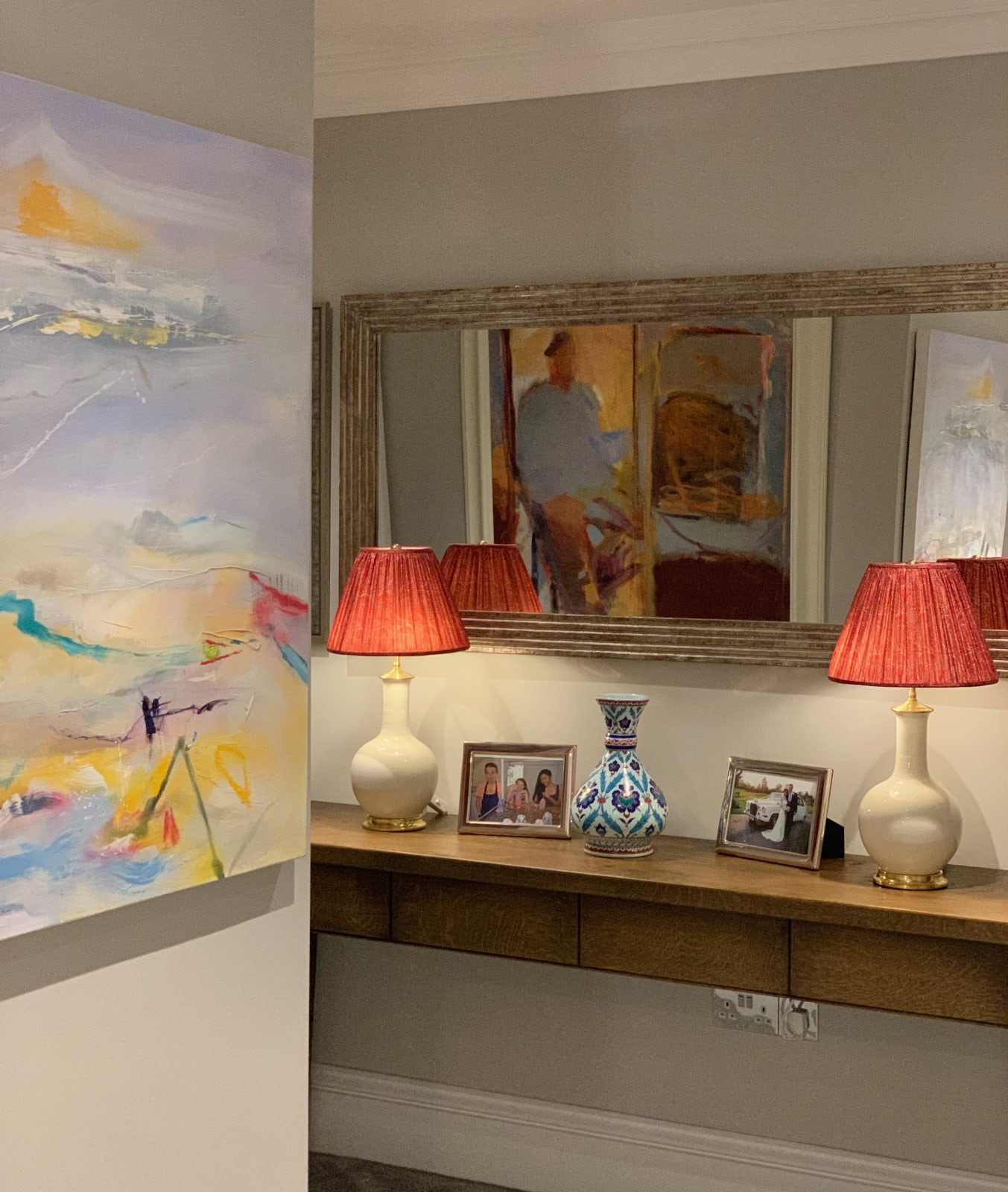 An eclectic mix of paintings, with an abstract by Heidi Koenig and a self portrait by Rose Hilton