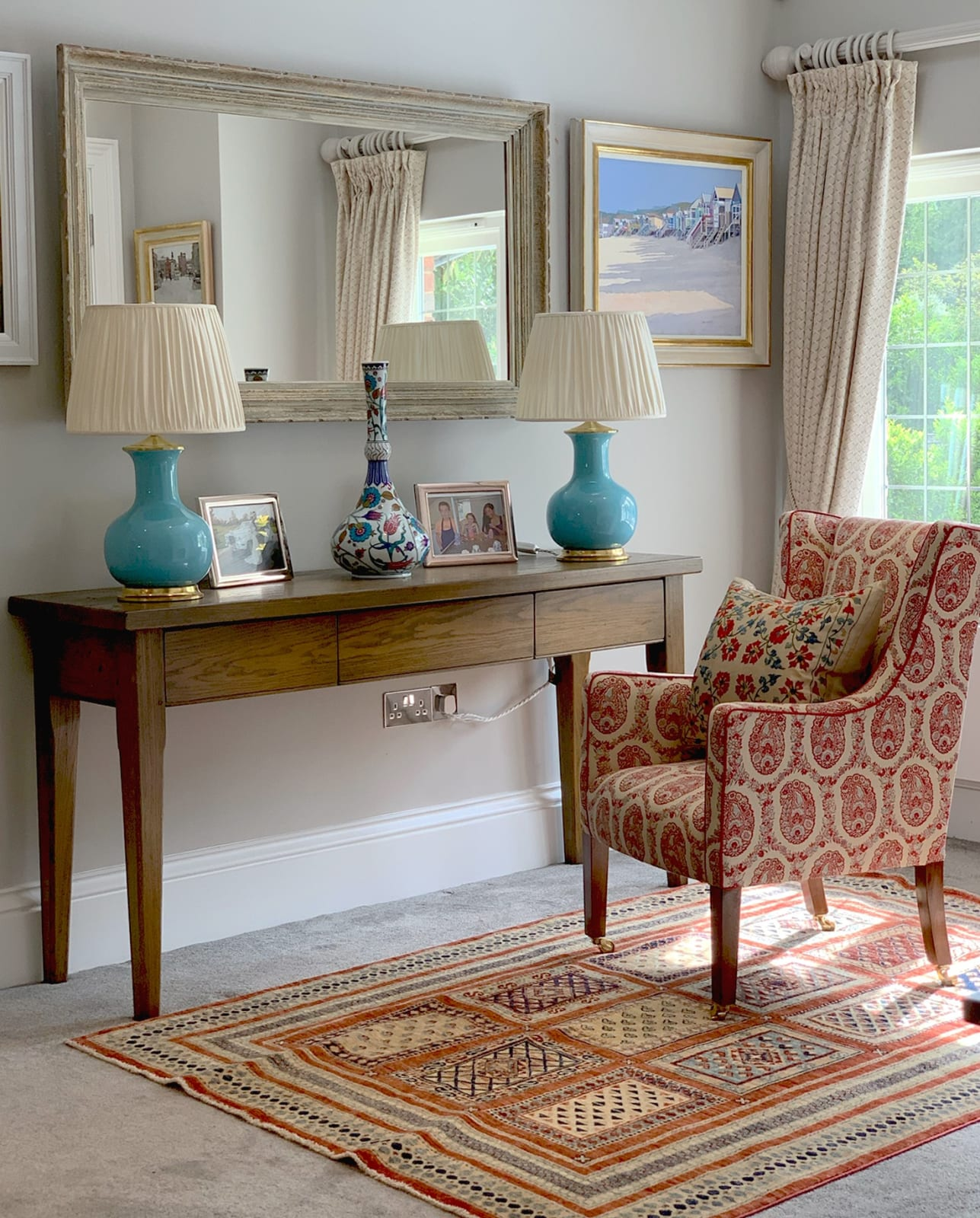 An original painting by John Spakes ROI in this interior with Susan Deliss fabrics and stunning Christopher Spitzmiller lamps.
