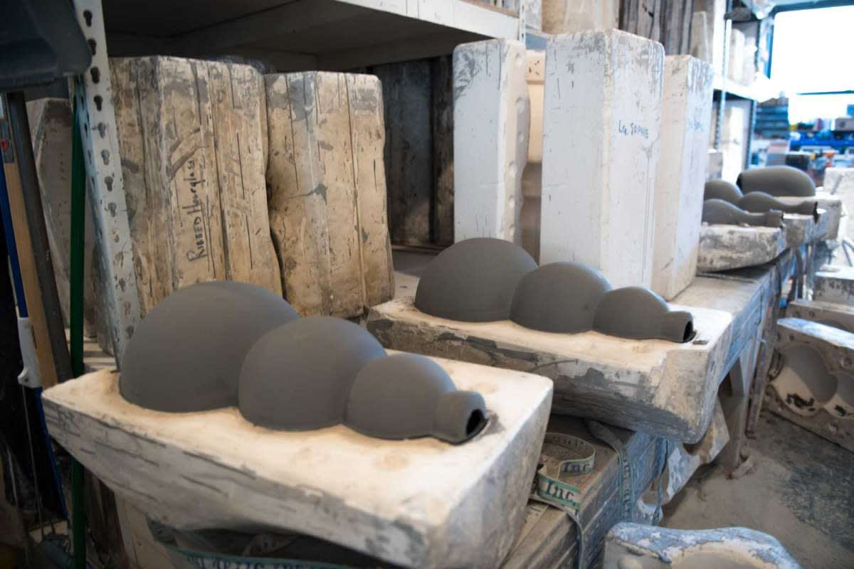 The lamps are first slip-cast by an artisan using a plaster mold and allowed to set for a day