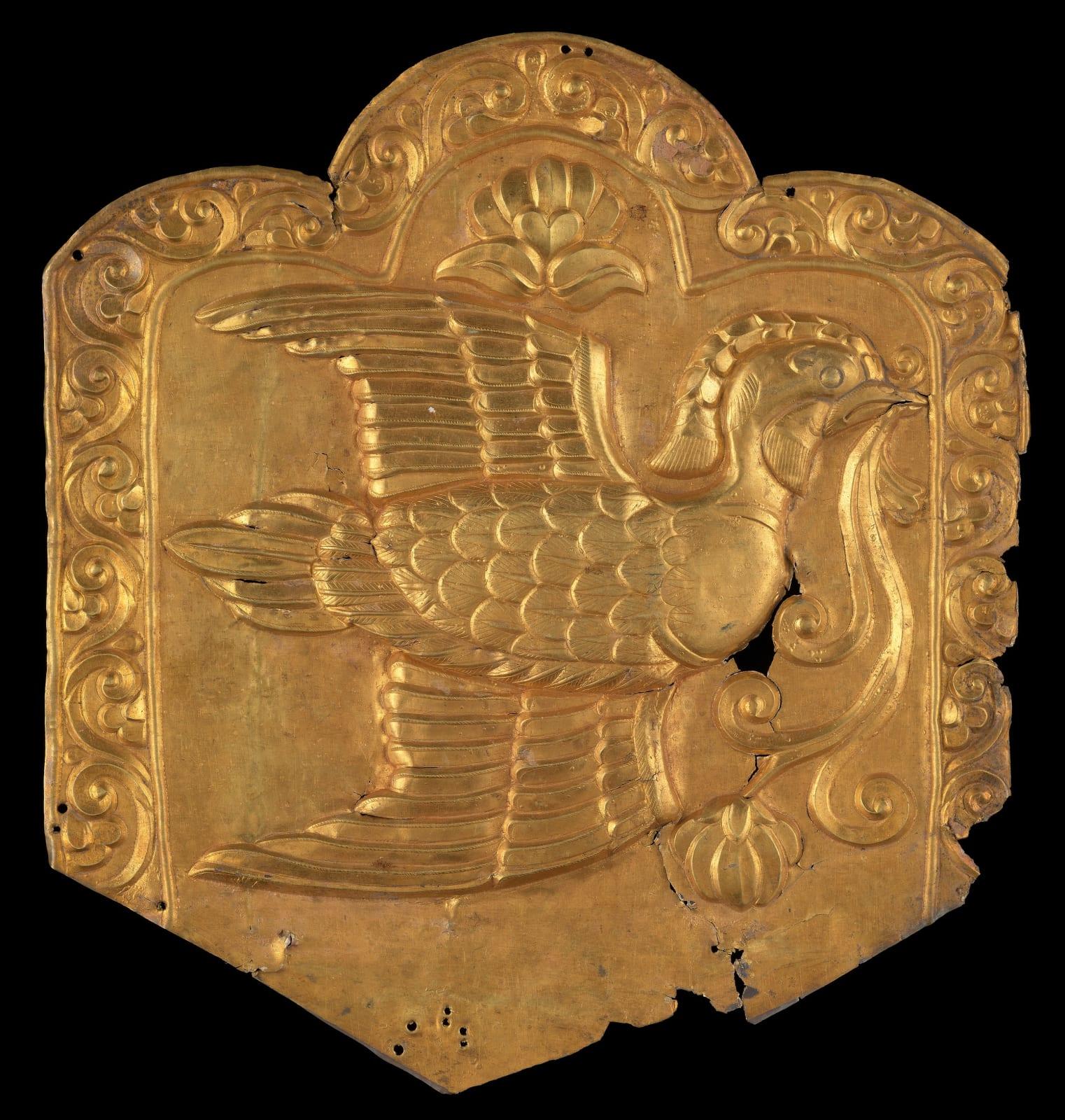 Silver-gilt repoussé plaque depicting a mandarin duck in flight, Central Asia, 7th – 9th century