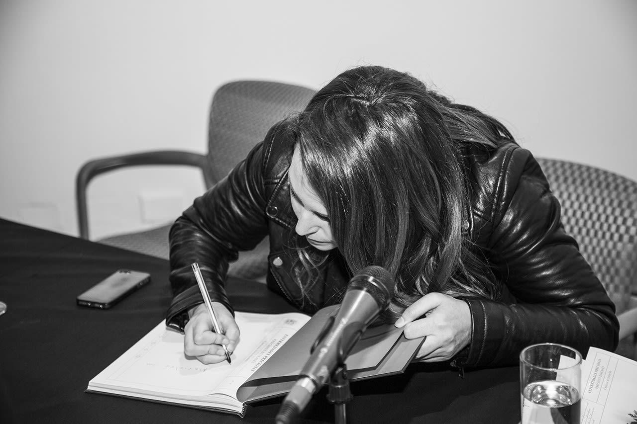 Artist Cecilia Avendaño dedicating copies of her book Enfermedades Preciosas. Photo: Cristián Aninat.