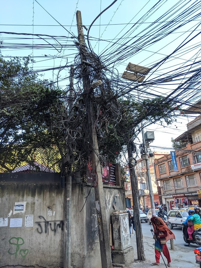 Tangled bushes of wires run cable, internet, phone and power to the residents of Kathmandu, 2019