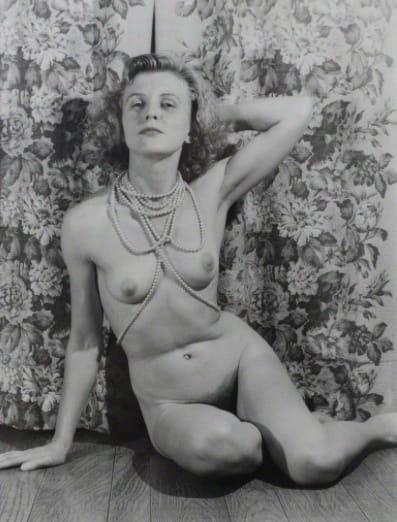 Eugene Von Bruenchenhein, Untitled (Marie nude with pearls, arm behind head, looks to viewer), ca. 1940