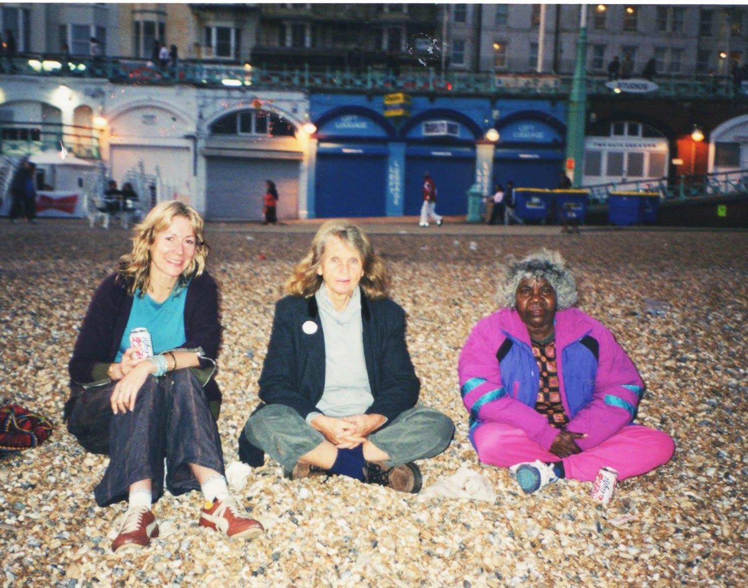 Rebecca Hossack, Pat Lowe and Jukuna Mona Chuguna on Brighton Beach
