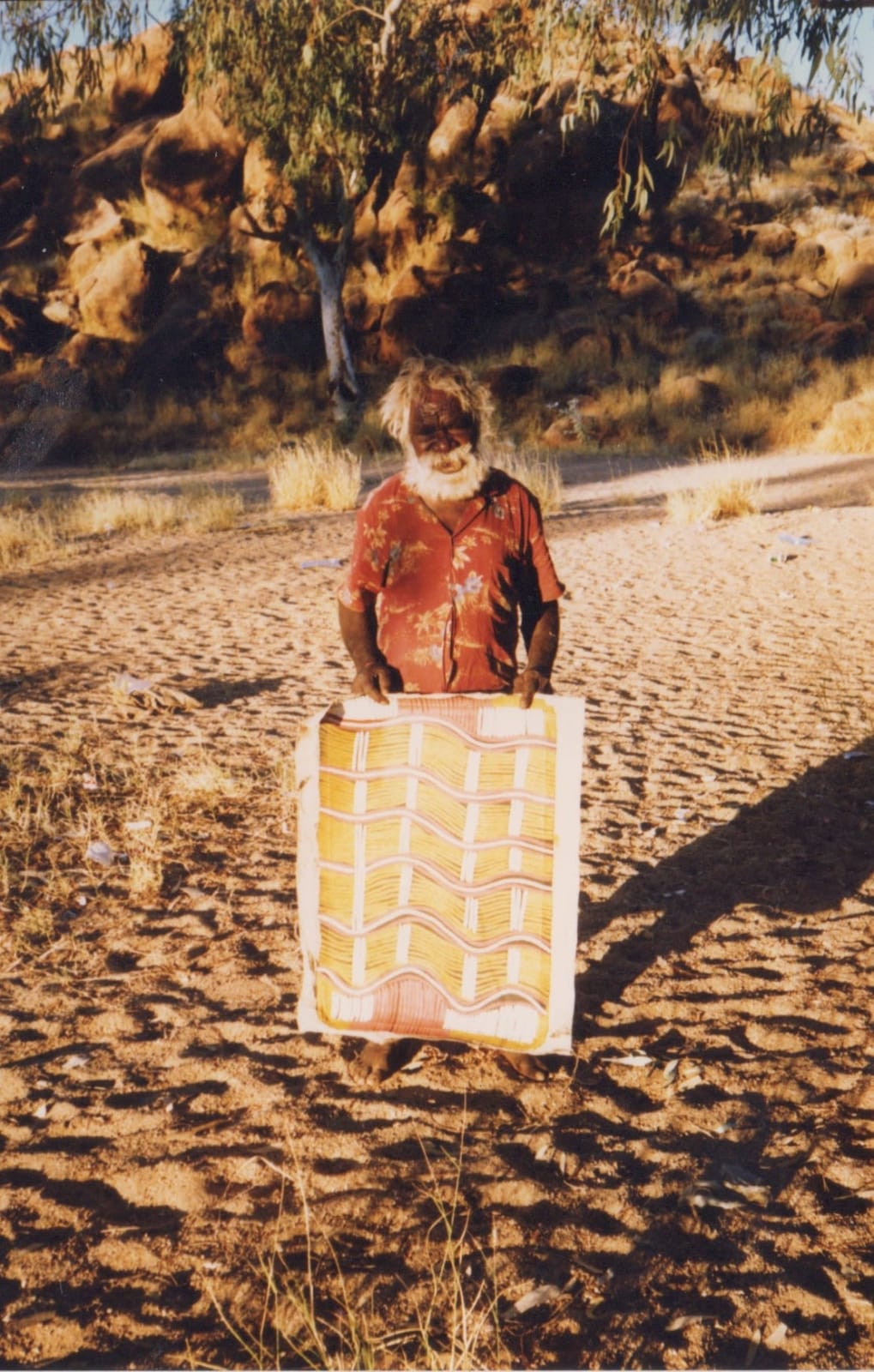 Billy Stockman with his painting at Papunya
